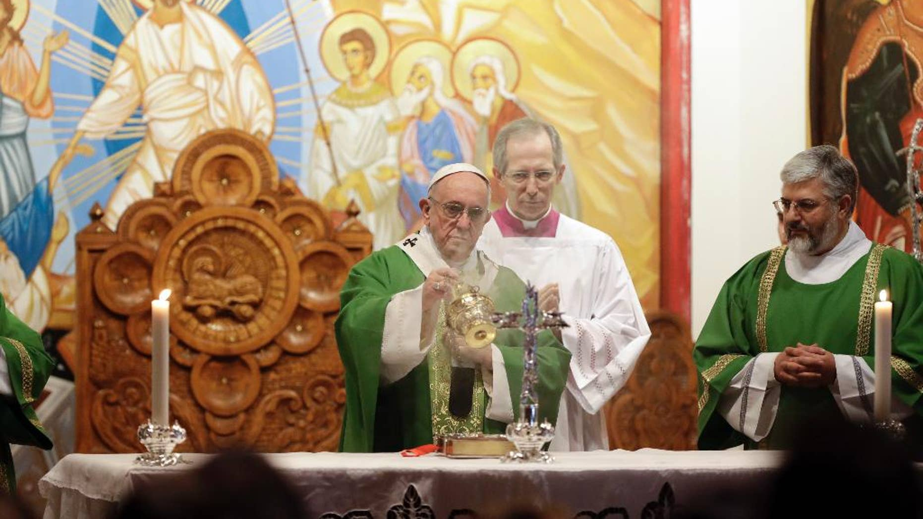 Pope Francis incenses the altar as he celebrates Mass at the St. Mary of Setteville di Guidonia parish church, in the outskirts of Rome, Sunday, Jan. 15, 2017. (AP Photo/Andrew Medichini)