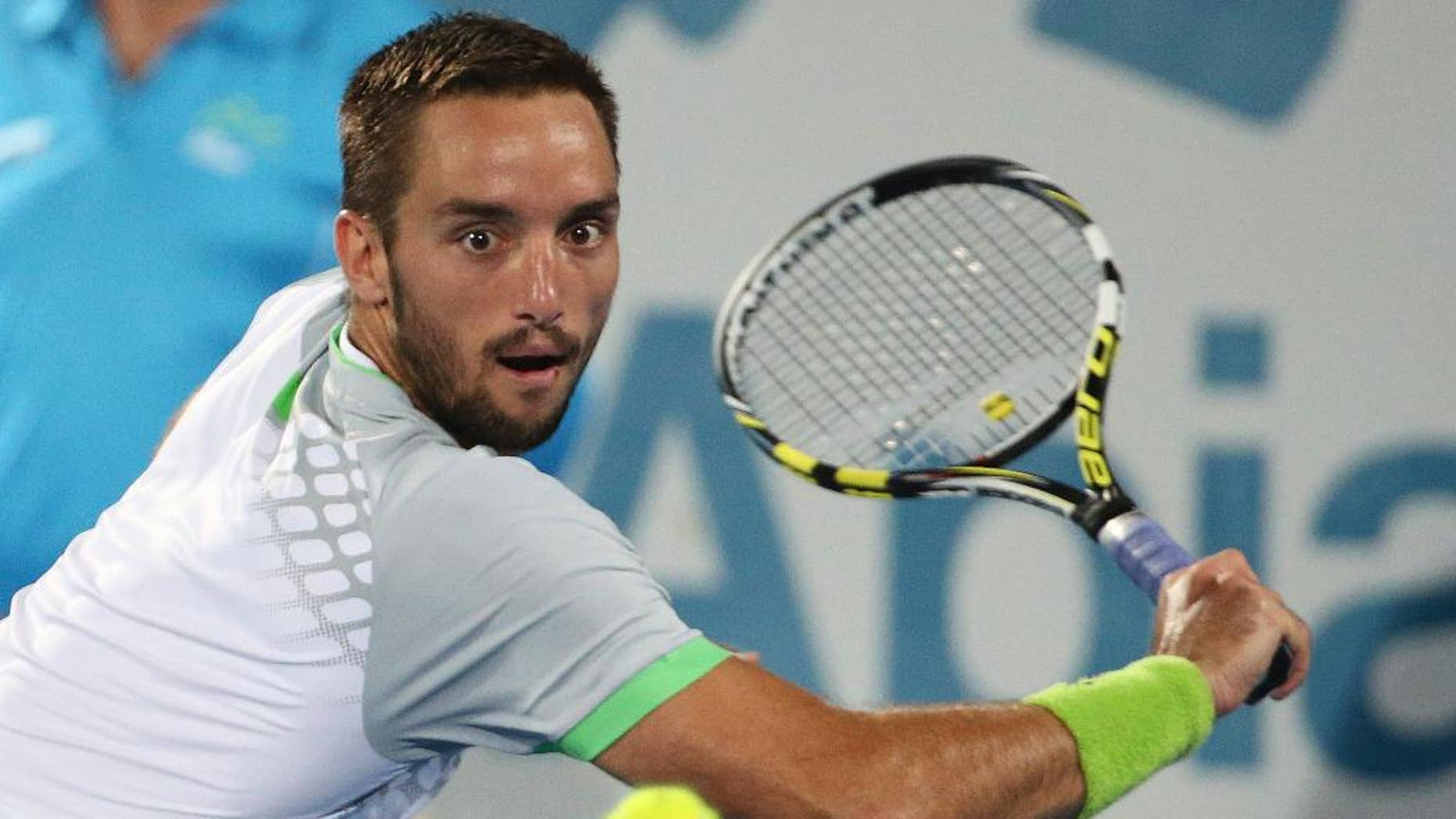 Viktor Troicki of Serbia plays a shot in the men's final against Mikhail Kukushkin of Kazakhstan at the Sydney International Tennis tournament in Sydney, Saturday, Jan. 17, 2015. (AP Photo/Rob Griffith)