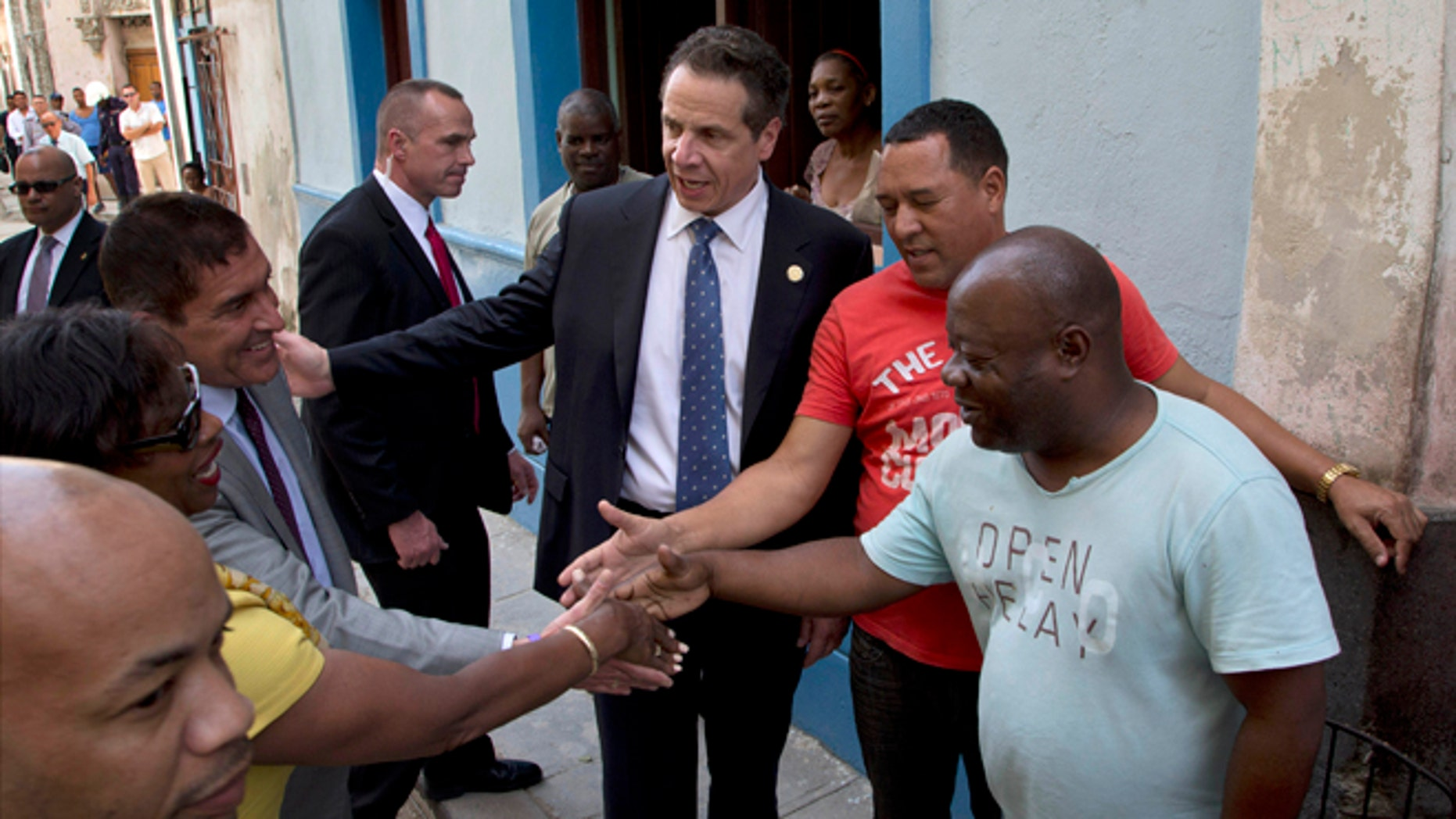 New York Governor Andrew Cuomo, center, introduces New York politicians to Cuban citizens on a street in old Havana, Cuba, Monday, April 20, 2015. From left are Carl E. Heastie, speaker of the New York Assembly, New York State Senator Andrea Stewart-Cousins and New York State Senator Jeff Klein. The formal state visit, a trip that makes Cuomo the first American governor to visit the island since the recent thaw in relations with the communist nation, is meant to foster greater ties between New York and Cuba. (AP Photo/Ramon Espinosa)