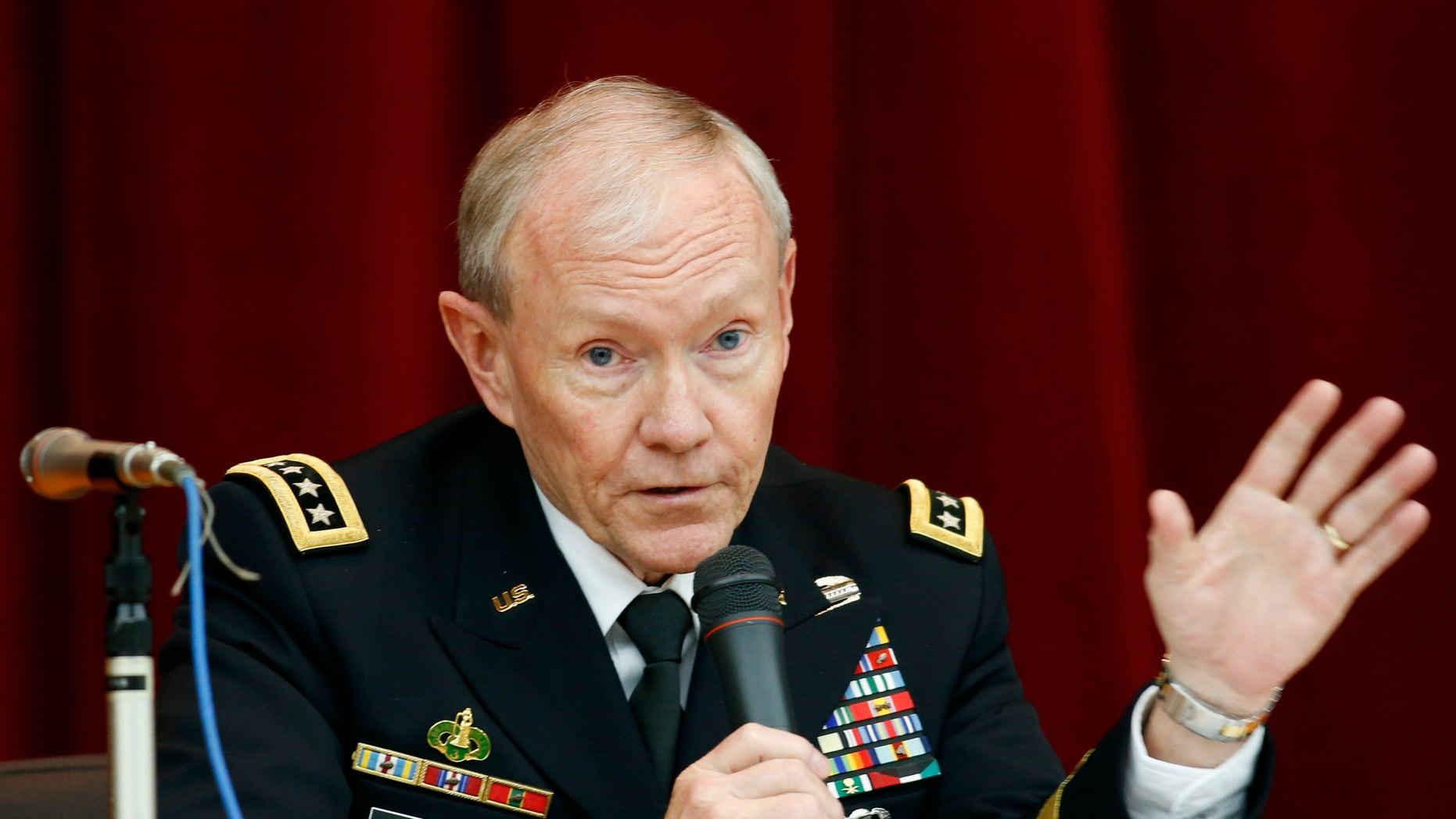 FILE - In this April 26, 2013, file photo, Chairman of the Joint Chiefs of Staff Gen. Martin Dempsey speaks during his lecture at Joint Staff College in Tokyo. One after another, the charges have tumbled out _ allegations of sexual assaults in the military that have triggered outrage, from local commanders to Capitol Hill and the Oval Office. But for the Pentagon there seem to be few clear solutions beyond improved training and possible adjustments in how the military prosecutes such crimes. Changing the culture of a male-dominated, change-resistant military that for years has tolerated sexism and sexist behavior is proving to be a challenging task. (AP Photo/Koji Sasahara, File)