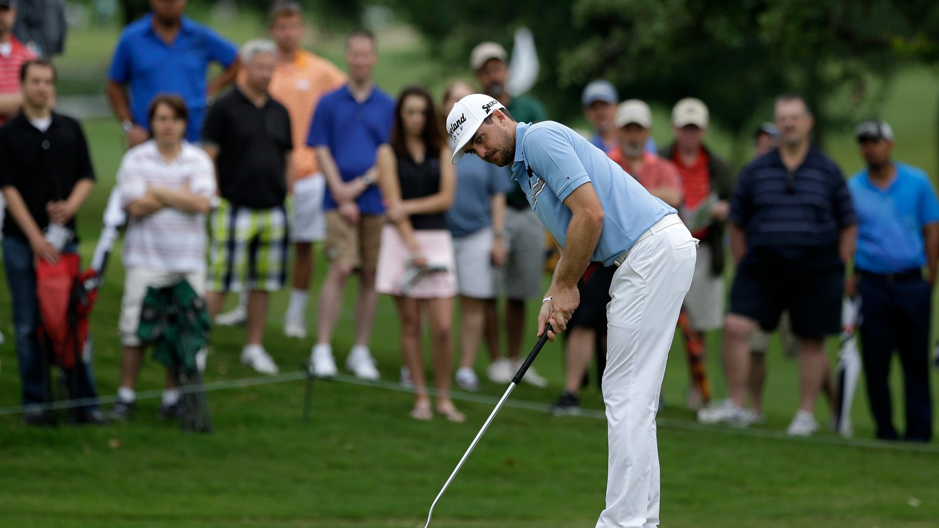 Keegan Bradley watches his birdie putt on the second green during the first round of the Byron Nelson Championship golf tournament Thursday, May 16, 2013, in Irving, Texas. Bradley finished the day with course record 10-under par 60. (AP Photo/Tony Gutierrez)