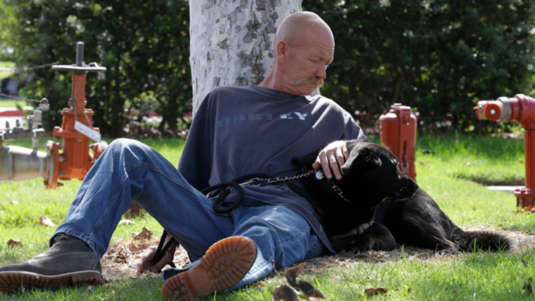 Oct. 6, 2012: Don Matyja, a homeless Army veteran poses for a picture with his dog Tyson at Lions park in Costa Mesa, Calif.