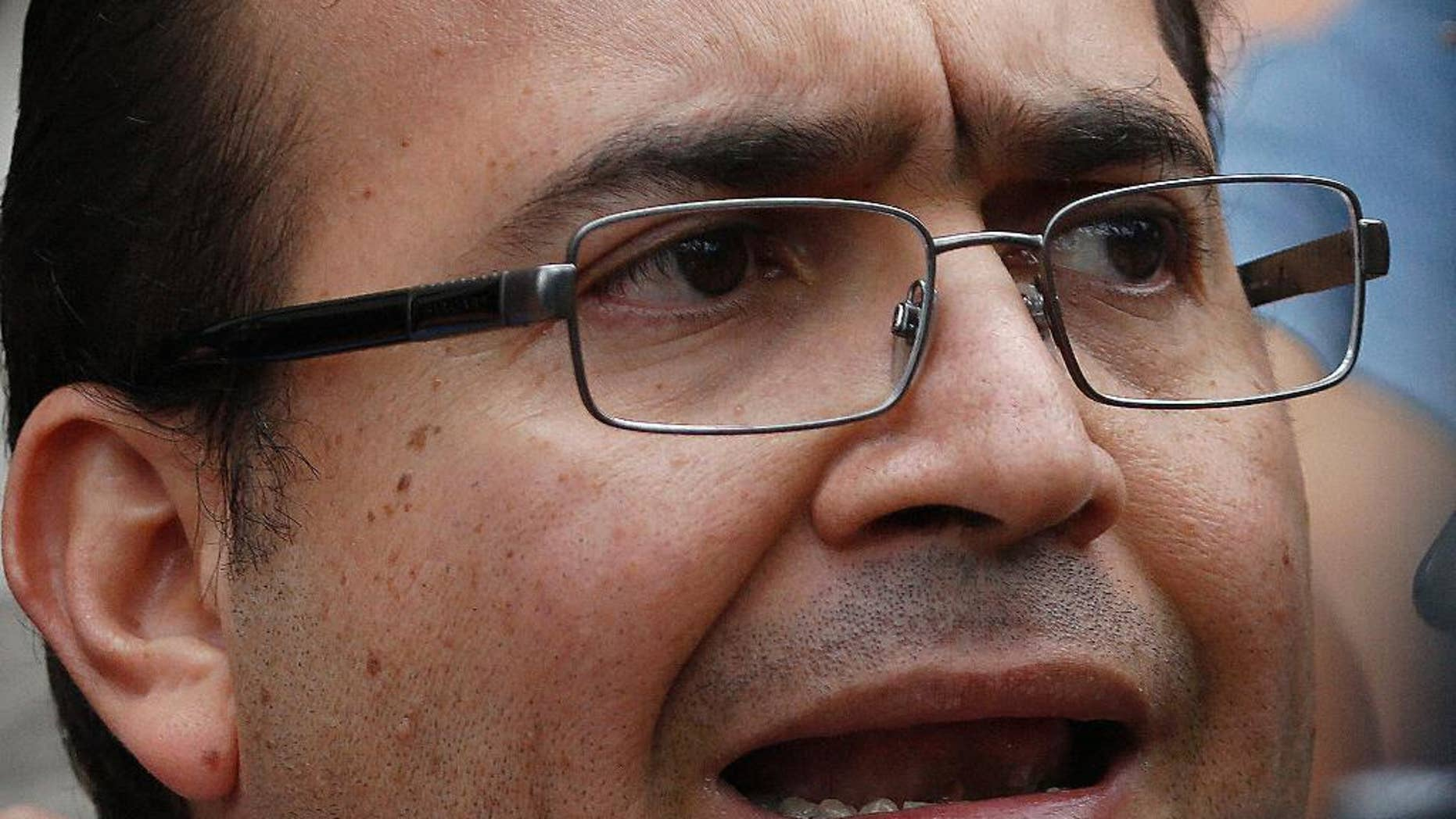 FILE - In this Aug. 5, 2016, file photo, the former Governor of Veracruz state, Javier Duarte speaks to reporters as he leaves the Attorney General's headquarters in Mexico City. The Authorities announced Sunday, Nov. 13 that the government has frozen 112 bank accounts and temporarily seized four properties and five businesses linked Duarte, who is facing charges of money laundering and organized crime. (AP Photo/Marco Ugarte, File)