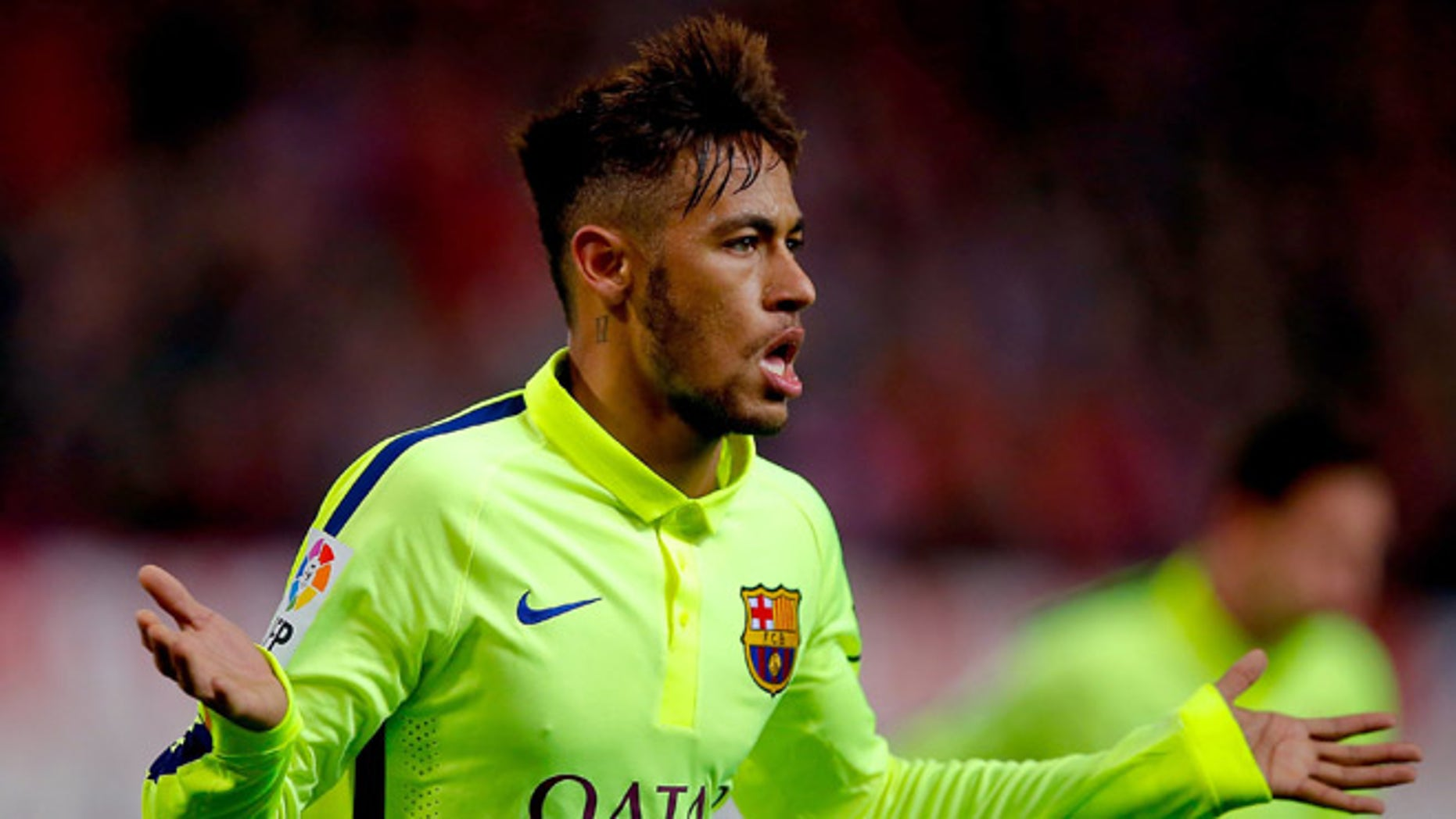 MADRID, SPAIN - JANUARY 28:  Neymar JR. of FC Barcelona celebrates scoring their third goal during the Copa del Rey Round of 8 second leg match between Club Atletico de Madrid and FC Barcelona at Vicente Calderon Stadium on January 28, 2015 in Madrid, Spain.  (Photo by Gonzalo Arroyo Moreno/Getty Images)