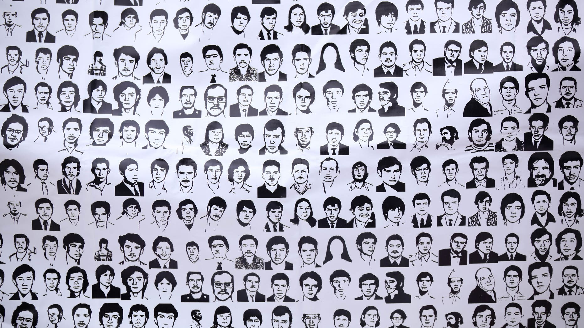 FILE - In this May 10, 2012, file photo, a banner shows ink drawings of missing people at the National March for Dignity on the day Mexicans celebrate el Dia de La Madre, or Mother's Day, in Mexico City. Propuesta Civica, or Civic Proposal, a civic organization released on its website on Thursday, Dec. 20, 2012, a database, allegedly collected by the federal Attorney General's Office, it says contains official information on more than 20,000 people who have disappeared in Mexico over the past six years. (AP Photo/Alexandre Meneghini, file)