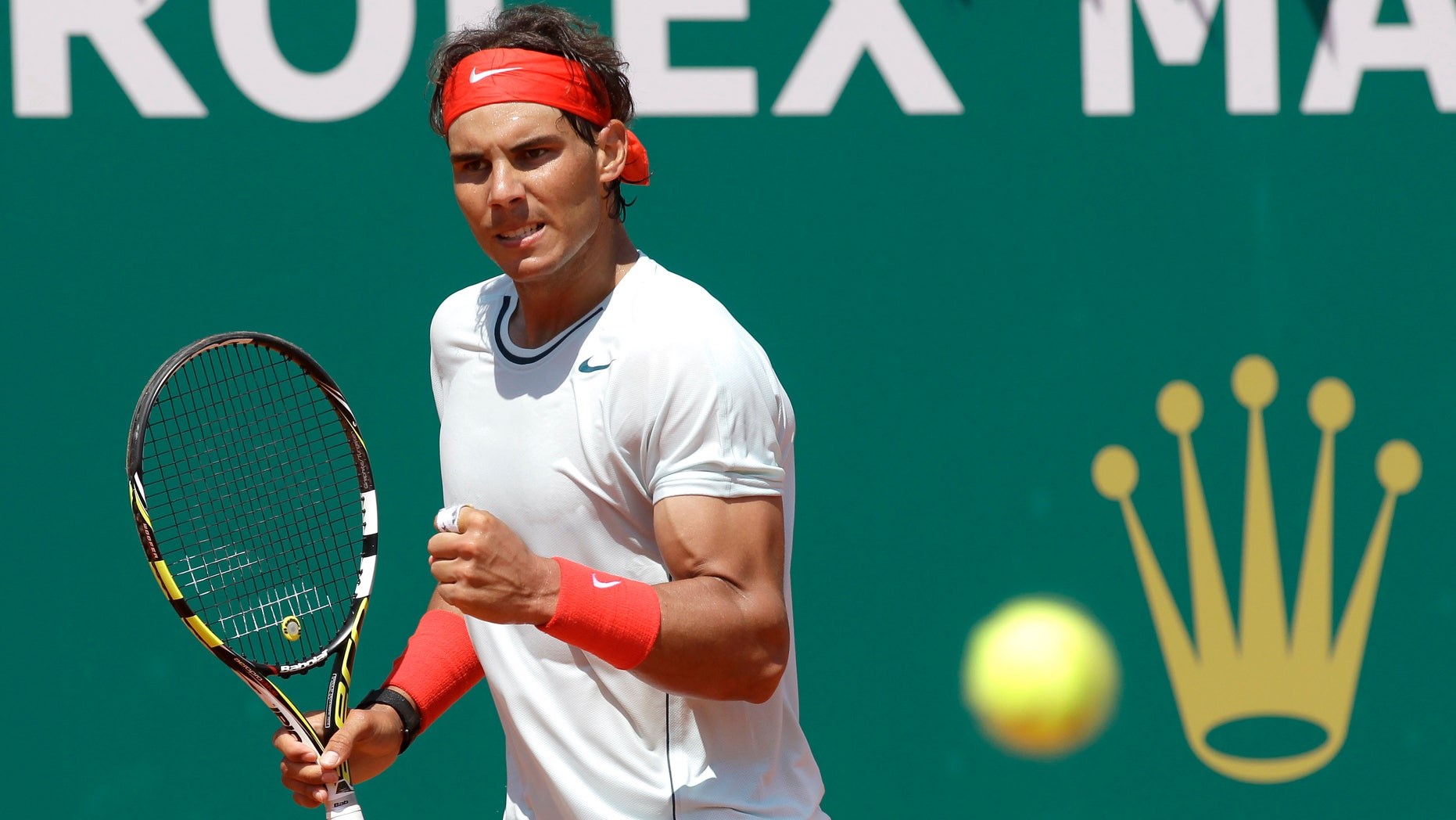 Spain's Rafael Nadal reacts during his match against Philipp Kohlschreiber of Germany at the Monte Carlo Tennis Masters tournament in Monaco, Thursday, April 18, 2013. (AP Photo/Lionel Cironneau)