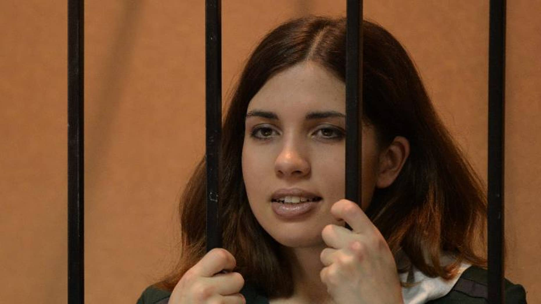 """""""Pussy Riot"""" punk Nadezhda Tolokonnikova waits in the defendant's cage at a courthouse in Zubova Polyana, on April 26, 2013."""