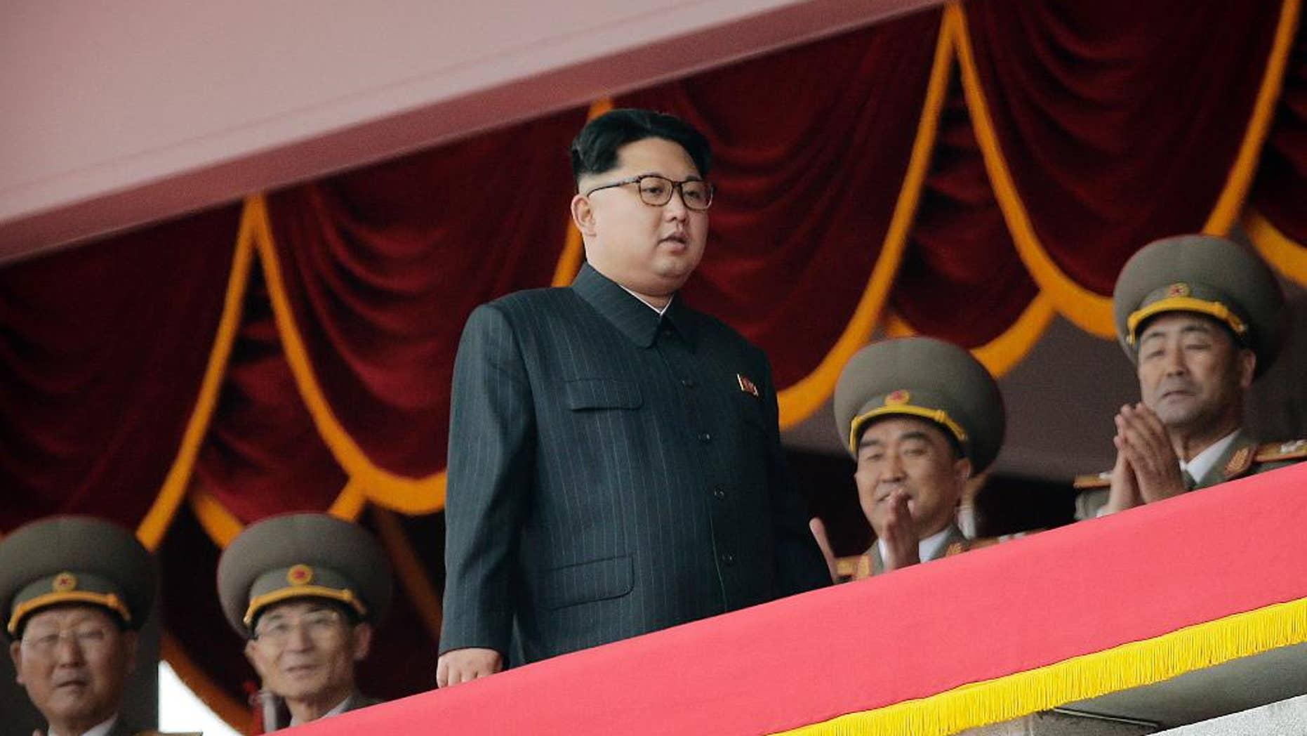 North Korean leader Kim Jong Un, center, watches parade participants from a balcony at the Kim Il Sung Square on Tuesday, May 10, 2016, in Pyongyang, North Korea. Hundreds of thousands of North Koreans celebrated the country's newly completed ruling-party congress with a massive civilian parade featuring floats bearing patriotic slogans and marchers with flags and pompoms. (AP Photo/Wong Maye-E)