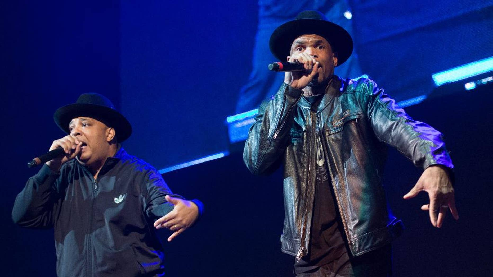 FILE - In this Dec. 19, 2014 file photo, Joseph Simmons, left, and Darryl McDaniels of Run DMC perform at Christmas in Brooklyn at the Barclays Center in the Brooklyn borough of New York. Run DMC is expected to open for the Red Hot Chili Peppers at the sixth-annual DirecTV Super Saturday Night concert in San Francisco the night before the Super Bowl. (Photo by Scott Roth/Invision/AP, File)