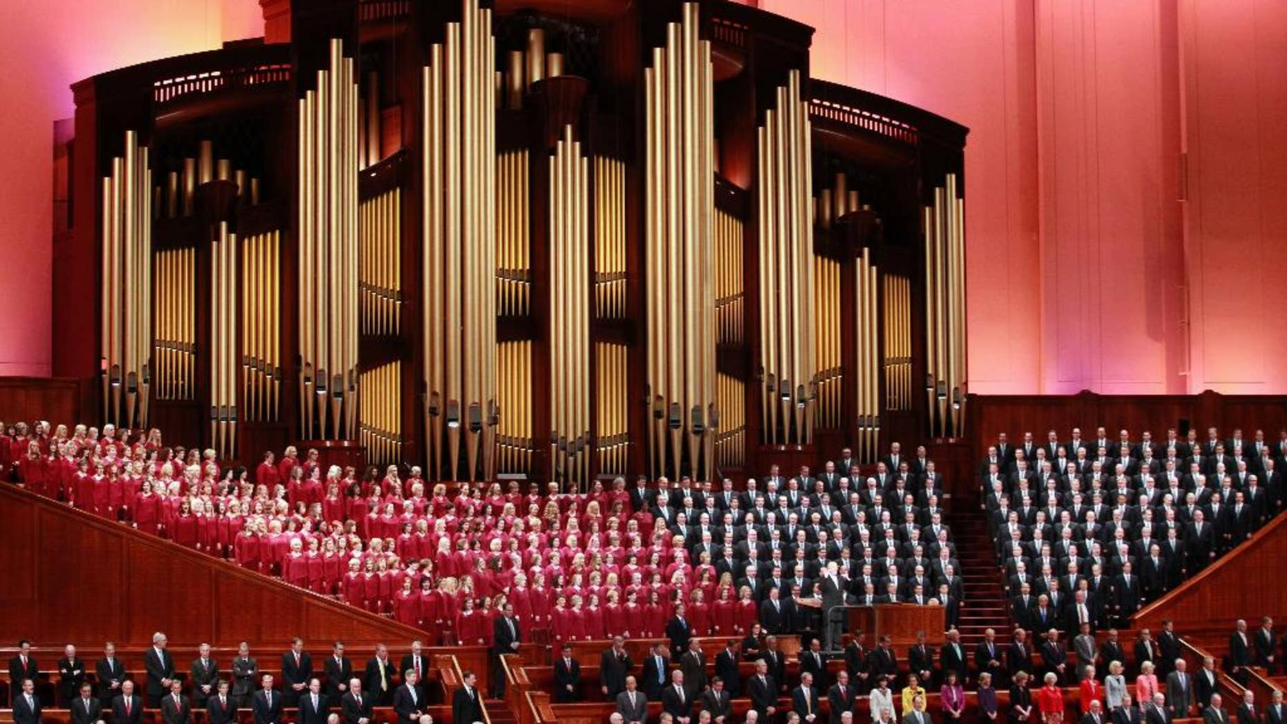 """FILE - In this Oct. 1, 2016, file photo, the Mormon Tabernacle Choir of The Church of Jesus Christ of Latter-day Saints, sings in the Conference Center at the morning session of the two-day Mormon church conference in Salt Lake City. Choir member Jan Chamberlin posted a resignation letter that she says she sent to choir leaders on her Facebook page Thursdaym Dec. 29, 2016. In it, she writes that by performing at the inaugural, the 360-member Choir will appear to be """"endorsing tyranny and facism"""" and says she feels """"betrayed"""" by the choir's decision to take part. (AP Photo/George Frey, File)"""