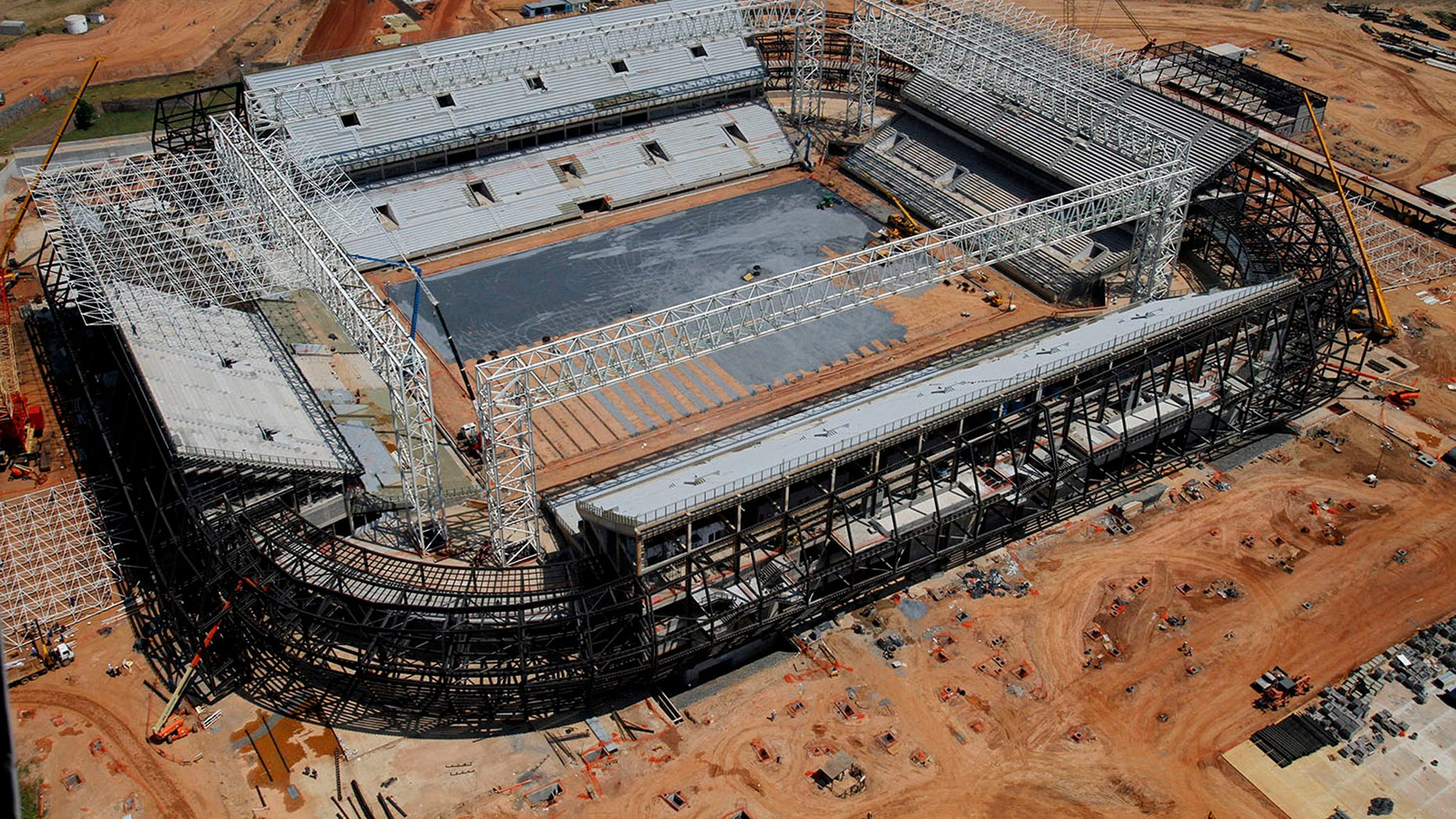 FILE - In this Sept. 2013 file photo released by Portal da Copa shows an aerial view of the Arena Pantanal stadium in Cuiaba, Mato Grosso state, Brazil. Brazil risks missing the December deadline for the delivery of its World Cup stadiums because of a court battle over the purchase of seats for this venue. (AP Photo/Edson Rodrigues, Portal da Copa, File)