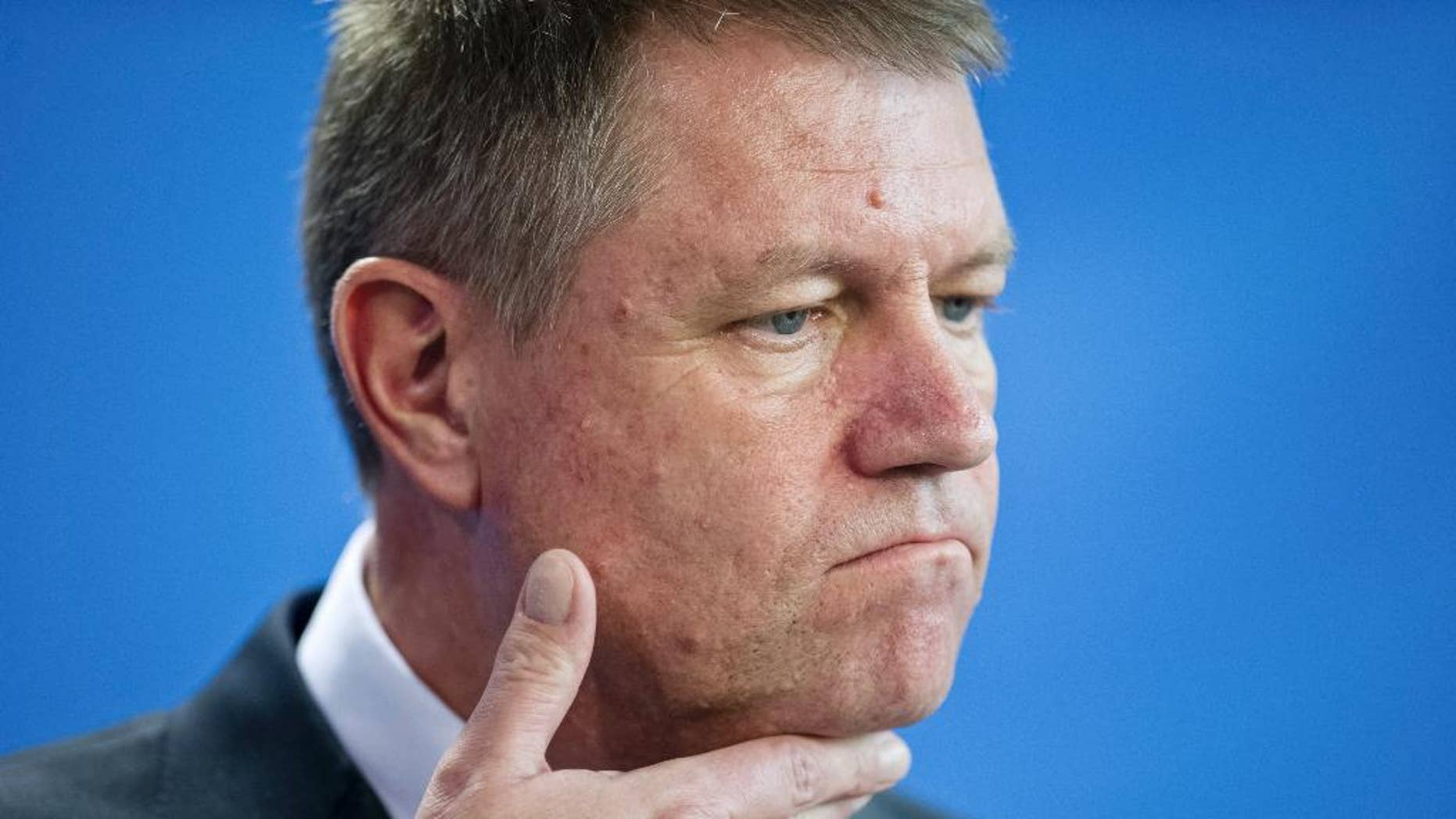 FILE - In this Thursday, Feb. 26, 2015 file picture Romanian President Klaus Iohannis attends a news conference after a meeting with German Chancellor Angela Merkel at the chancellery in Berlin, Germany. Romania's president has lost a bid to overturn a court case on a property he lost ownership of, following an 18-year court case. after a court in the southern city of Pitesti on Wednesday, Feb. 22, 2017 rejected his appeal for annulment on a lawsuit connected to a property he and his wife bought in 1999 in the central city of Sibiu. (AP Photo/Steffi Loos, File)