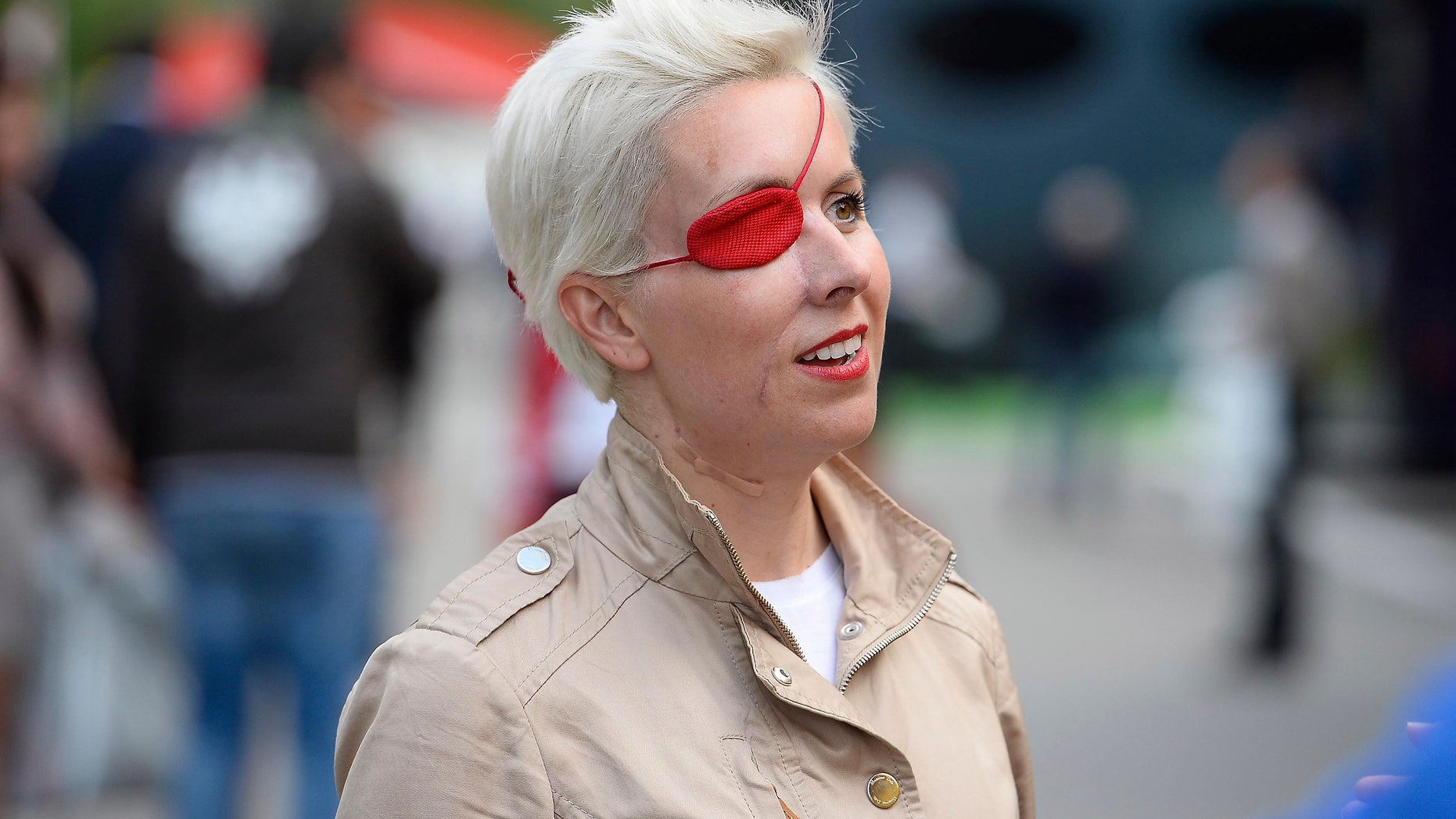 Spanish former F1 driver Maria De Villota is seen in the paddock after the second free practice session at the Catalunya racetrack in Montmelo, near Barcelona, Spain, Friday, May 10, 2013. Maria de Villota, a Spaniard who drove for Marussia, was the series' last full-time female driver since Italy's Giovanna Amati was with the Brabham team in 1992. But de Villota's career ended prematurely in July when she crashed into a team support vehicle in her first test of the team's MR-01 car. She lost her right eye in the accident and has not returned. (AP Photo)