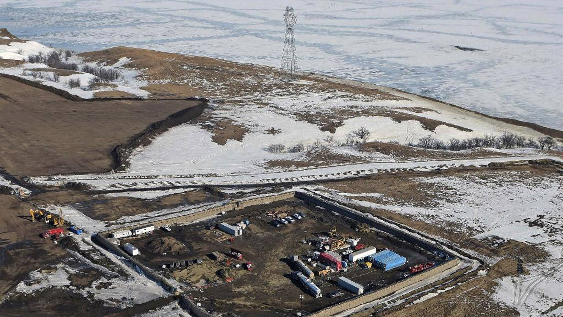 FILE - In this Feb. 13, 2017, aerial file photo shows the site where the final phase of the Dakota Access Pipeline will take place with boring equipment routing the pipeline underground and across Lake Oahe to connect with the existing pipeline in Emmons County near Cannon Ball, N.D. Sioux tribes suing to stop the Dakota Access pipeline want a federal judge to head off the imminent flow of oil. Judge James Boasberg on March 7, 2017, rejected the request of the Standing Rock and Cheyenne River Sioux to stop construction of the final segment of the pipeline that would move oil from North Dakota to Illinois. (Tom Stromme/The Bismarck Tribune via AP, File)