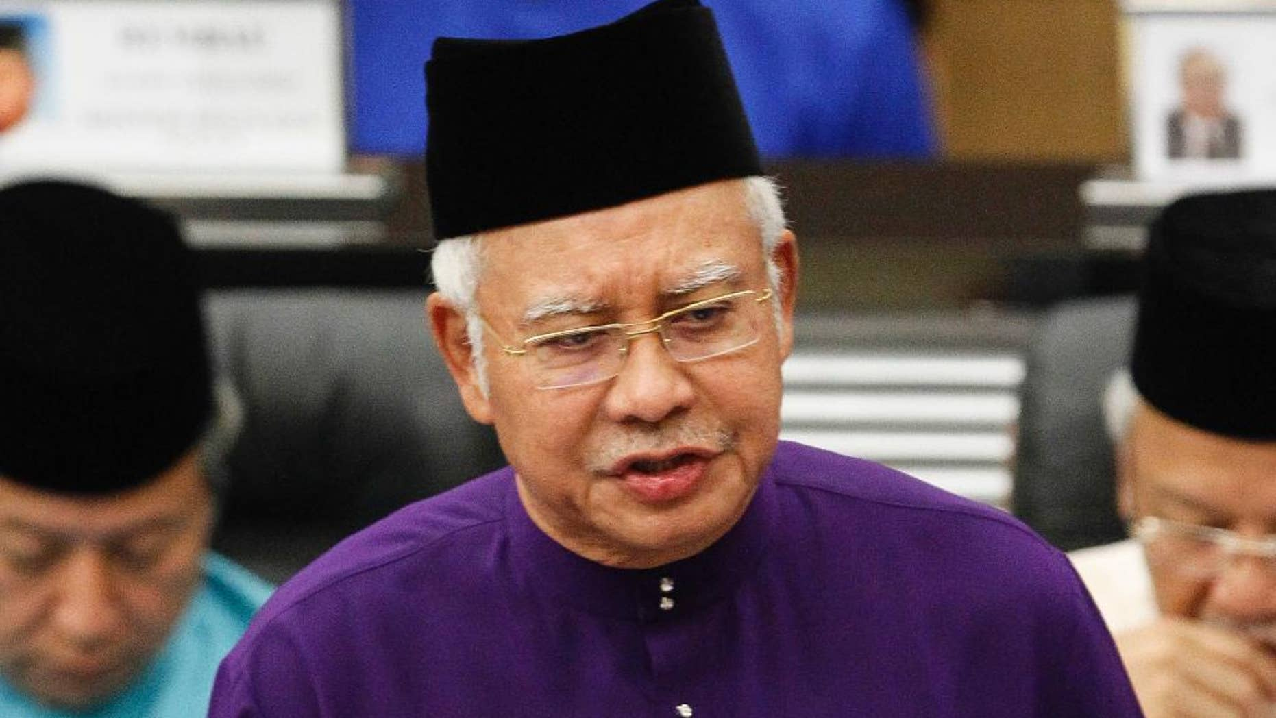 FILE - In this Oct. 23, 2015 file photo, Malaysian Prime Minister and Finance Minister Najib Razak speaks as he unveils the Malaysia's 2016 budget at Parliament House in Kuala Lumpur, Malaysia. Scandal-ridden Najib is seeking a big win for his ruling coalition in elections in the country's biggest state. More than 1.1 million people in Sarawak state on Borneo island are voting Saturday, May 7, 2016, for 82 lawmakers in the state assembly. (AP Photo/Joshua Paul, File)