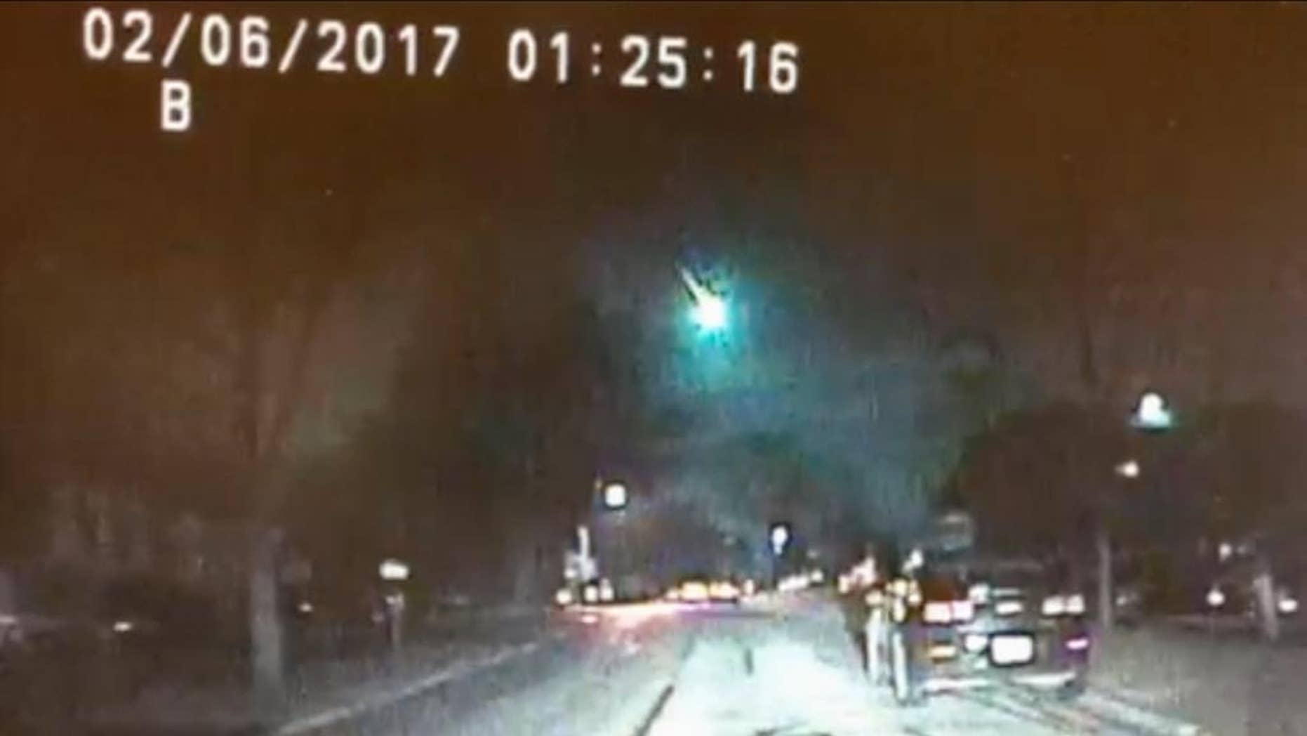 This image from a dashcam video provided by the Lisle Police Department in Lisle, Ill., shows a meteor as it streaked over Lake Michigan early Monday morning, Feb. 6, 2017. The meteor lit up the sky across several states in the Midwest. (Lisle (Ill.) Police Department via AP)