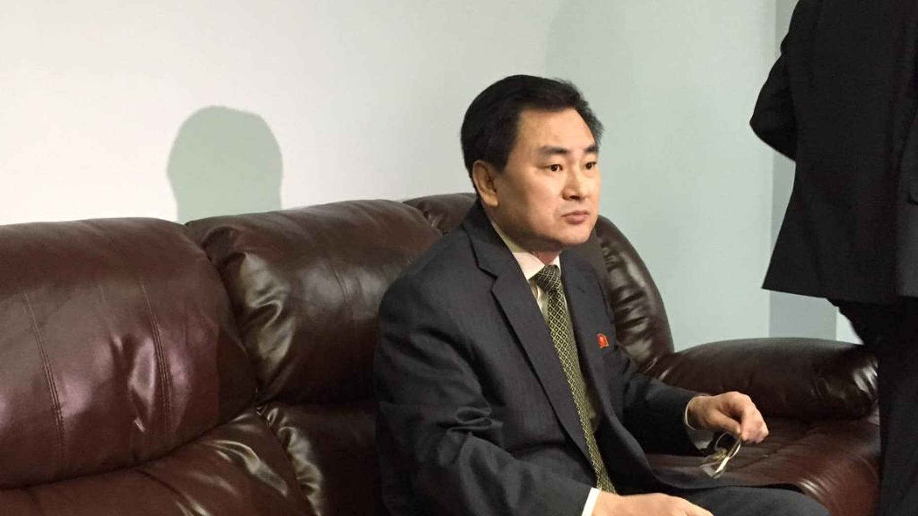 """North Korea's deputy permanent representative to the United Nations, An Myong Hun, waits to speak to reporters at North Korea's U.N. mission in New York, Wednesday April 8, 2015. Hun said Mexico has """"forcibly detained"""" one of its ships months after it ran aground off Mexico's Gulf coast and that his country will take unspecified """"necessary measures to make the ship leave immediately."""" An Myong Hun said the ship, the Mu Du Bong, was not carrying anything prohibited by U.N. sanctions and that more than 50 crew remain on board. (AP Photo/Cara Anna)"""