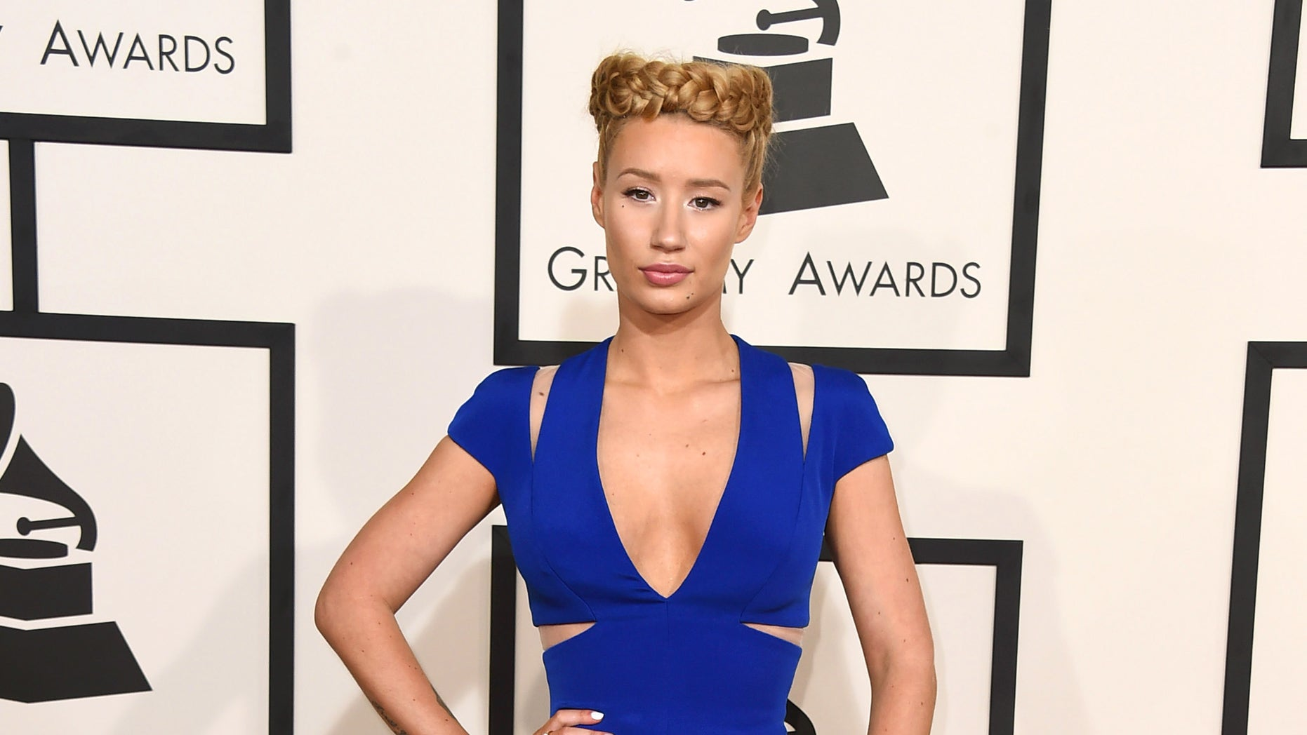 Iggy Azalea arrives at the 57th annual Grammy Awards at the Staples Center on Sunday, Feb. 8, 2015, in Los Angeles. (Photo by Jordan Strauss/Invision/AP)