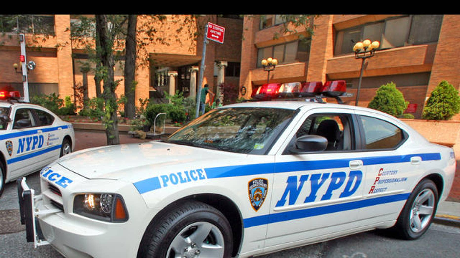 The new police cruisers, a 2006 Dodge Charger, are on display at New York City Police Department's headquarters in New York,  Monday, Aug. 14, 2006.  Police Commissioner Raymond Kelly unveiled the new police cruiser during a news conference Monday.  (AP Photo/Mary Altaffer)