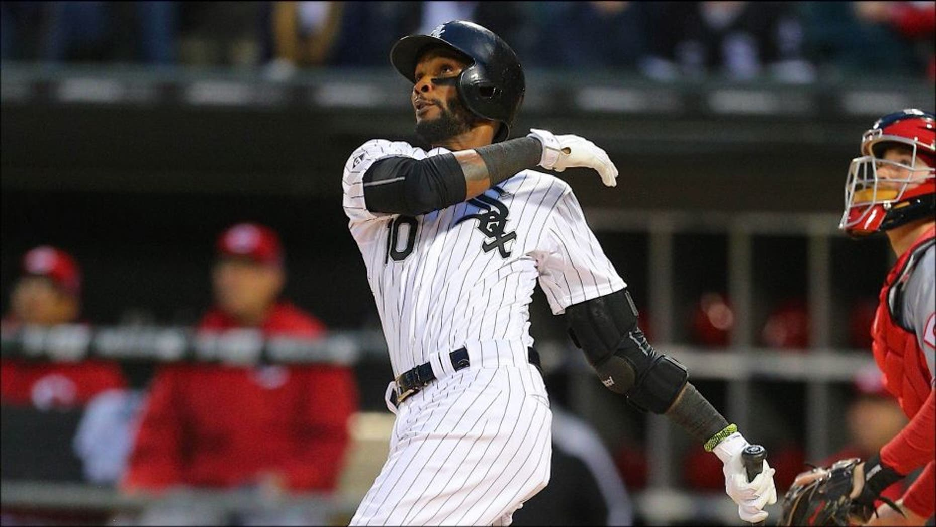 May 9, 2015; Chicago, IL, USA; Chicago White Sox shortstop Alexei Ramirez (10) hits a 2 run home run during the second inning in game two of a doubleheader against the Cincinnati Reds at U.S Cellular Field. Cincinnati won 10-4. Mandatory Credit: Dennis Wierzbicki-USA TODAY Sports