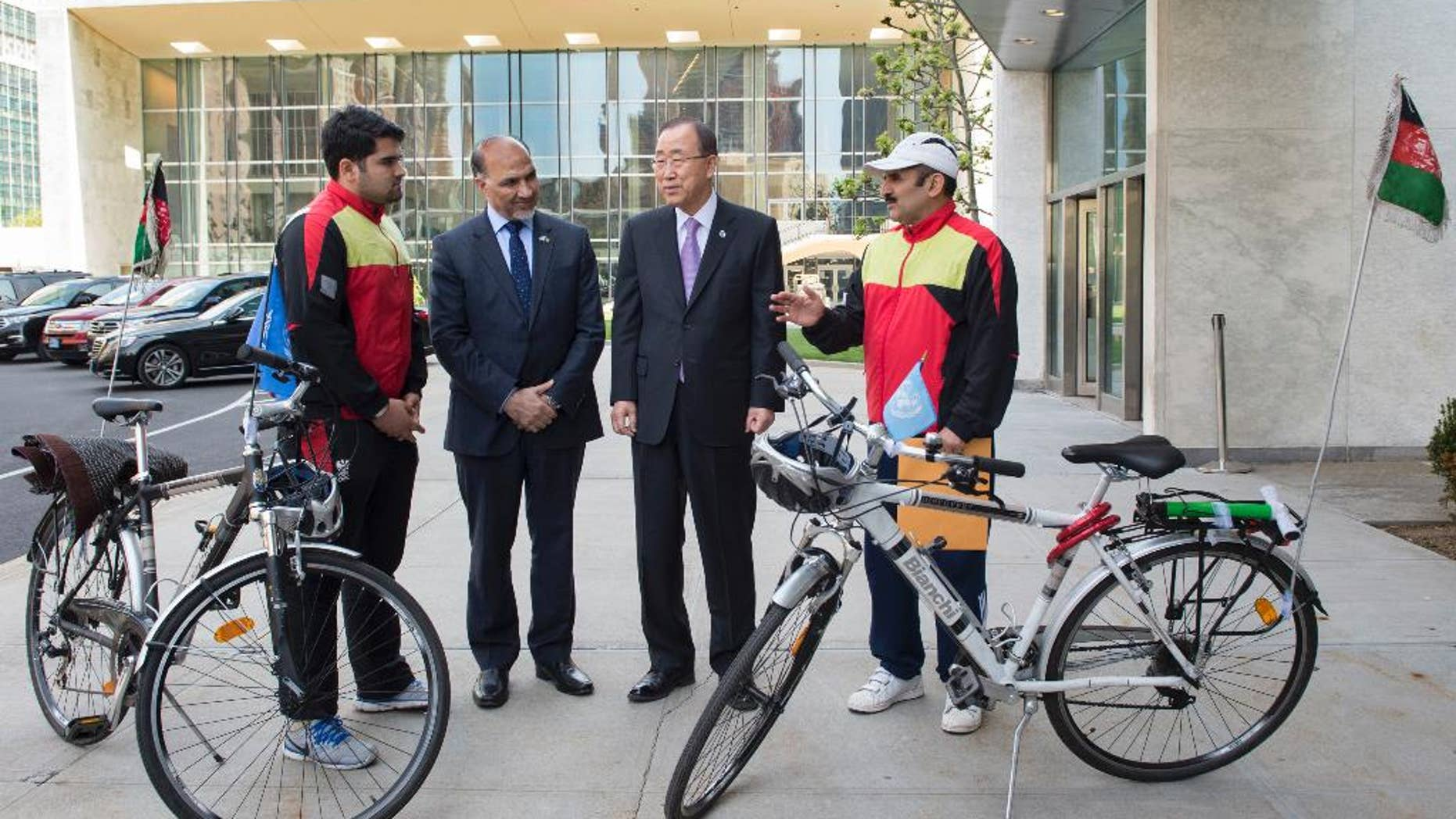 In this photo provided by the United Nations, United Nations Secretary General Ban Ki-moon, center-right, meets with Nader Shah Nangarhari, right, and his son Firoz Khan, left, on the grounds of United Nations headquarters, Friday, May 20, 2016. The father and son team are on a round-the-world trip to promote peace. At center-left is Afghan ambassador to the United Nations, Mahmoud Saikal. (Eskinder Debebe/The United Nations via AP)