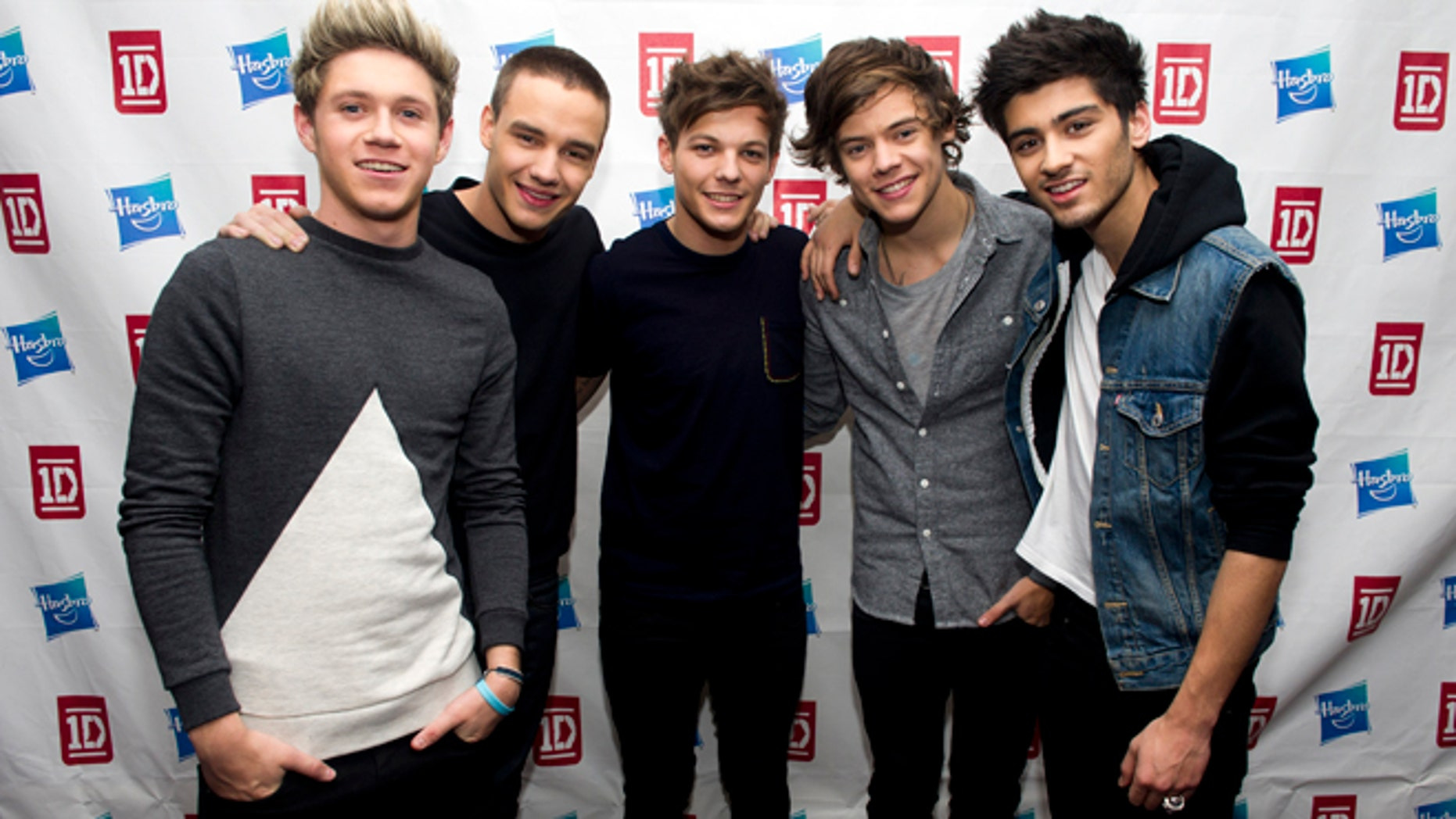 This Nov. 26, 2012 file photo released by hasbro shows members of One Direction, from left, Niall Horan, Liam Payne, Louis Tomlinson, Harry Styles and Zayn Malik at a Hasbro press event in New York.
