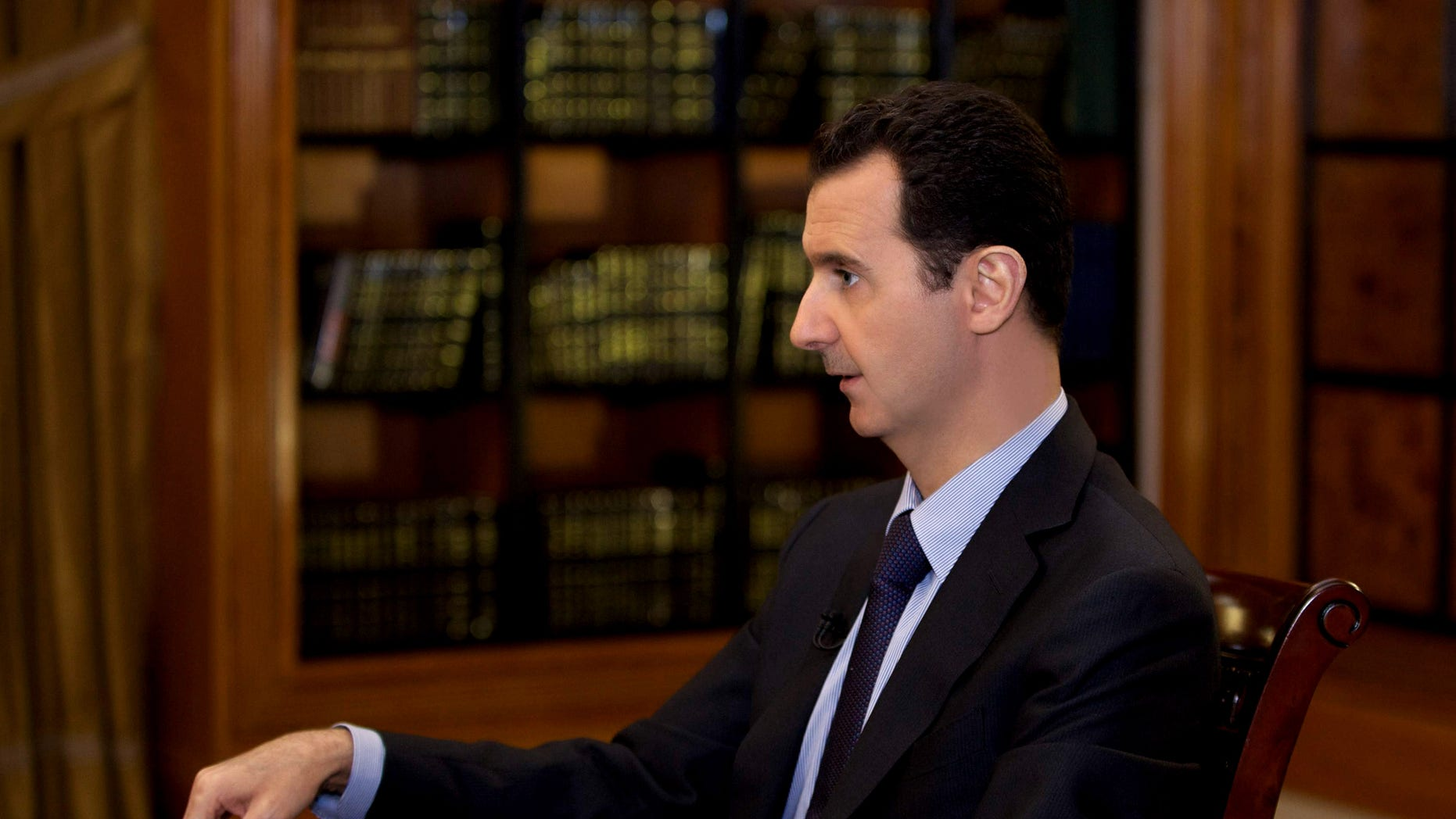 In this photo, which AP obtained from Syrian official news agency SANA and which has been authenticated based on its contents and other AP reporting, President Bashar Assad gestures as he speaks during an interview with Lebanon's Al-Mayadeen TV, at the presidential palace in Damascus, Syria, Monday, Oct. 21, 2013. Syria's president said Monday that the factors that would allow a landmark conference aimed at ending the country's civil war do not yet exist, throwing further doubt on international efforts to hold peace talks that have already been repeatedly delayed. (AP Photo/SANA)