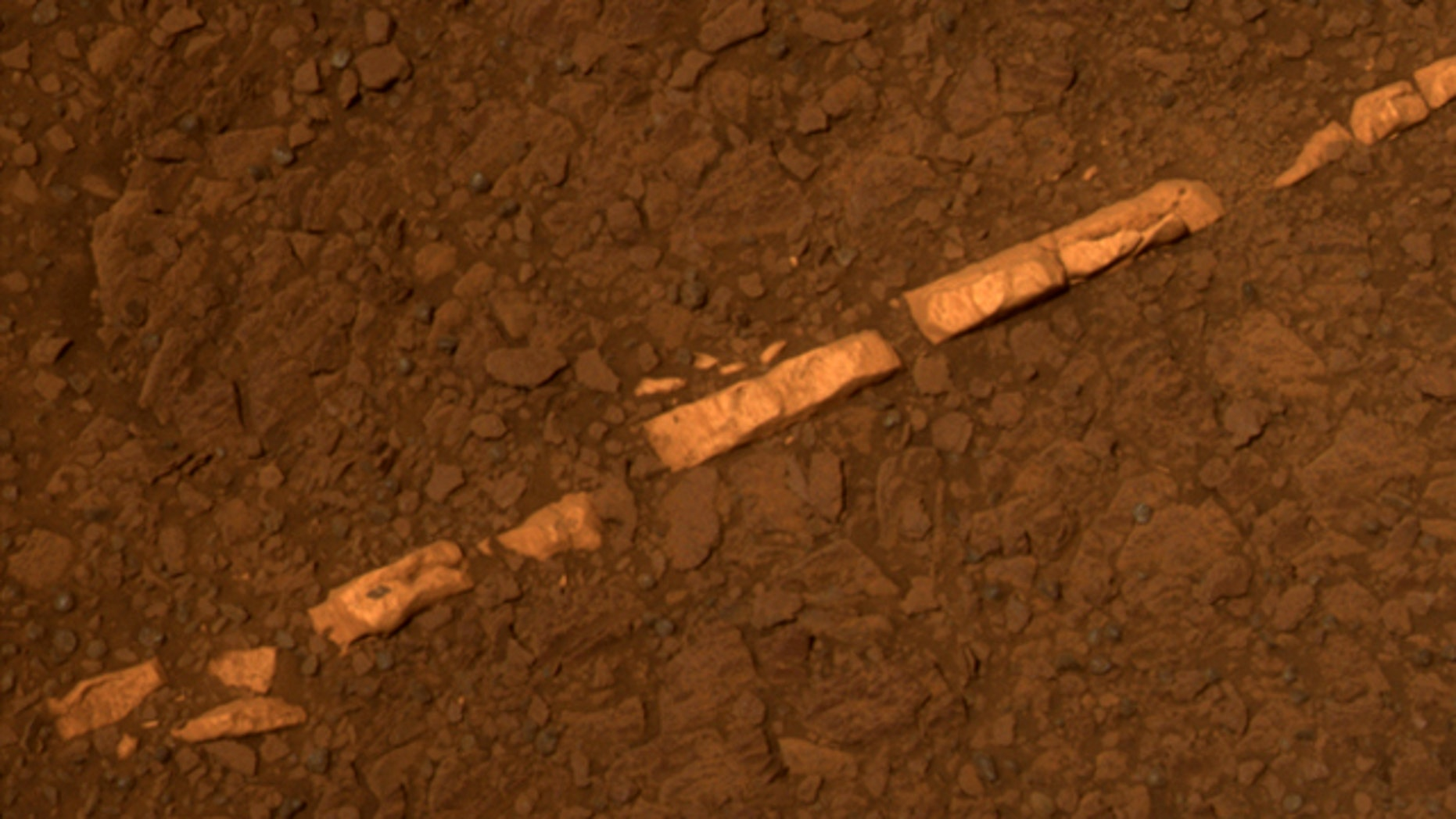 "This color view of a mineral vein called ""Homestake"" comes from the panoramic camera on NASA's Mars Exploration Rover Opportunity."