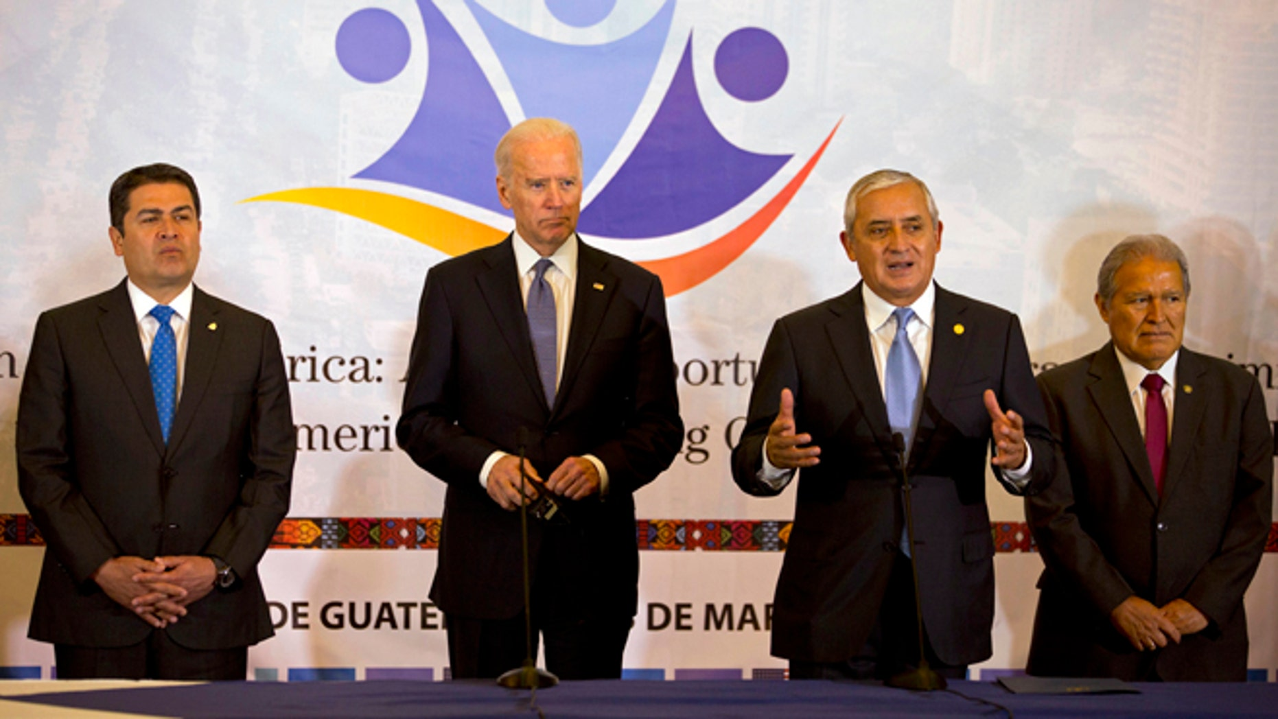 Honduras' President Juan Orlando Hernandez, left, U.S. Vice President Joe Biden, second left, and El Salvador's President Salvador Sanchez, right, stand as Guatemala's President Otto Perez Molina, second from right, talks during a working session in Guatemala City, Tuesday, March 3, 2015. Biden has arrived in Guatemala for a two-day visit with Central American presidents to discuss funding priorities aimed at slowing migration. (AP Photo/Moises Castillo)