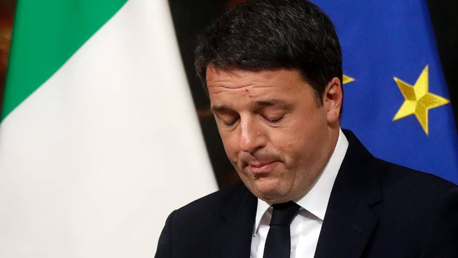Italian Premier Matteo Renzi speaks during a press conference at the premier's office Chigi Palace in Rome, early Monday, Dec. 5, 2016. Renzi acknowledged defeat in a constitutional referendum and announced he will resign on Monday. Italians voted Sunday in a referendum on constitutional reforms that Premier Matteo Renzi has staked his political future on. (AP Photo/Gregorio Borgia)