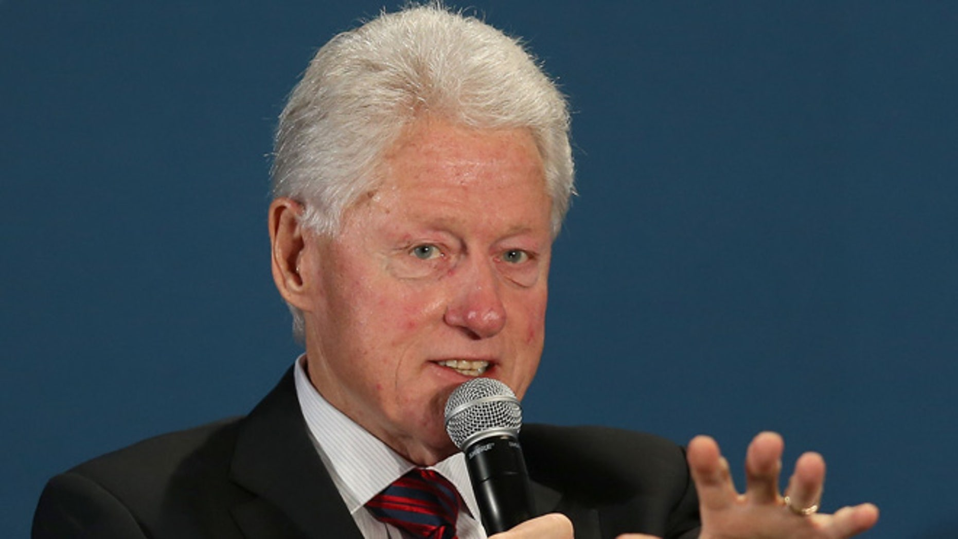 CORAL GABLES, FL - DECEMBER 11:  Former President Bill Clinton speaks during the  Clinton Foundations Future of the Americas summit at the University of Miami  on December 11, 2014 in Coral Gables, Florida. The summit is bringing together leaders from the private, public, and civic sectors across Latin America, the Caribbean, Canada, and the United States to work on economic prosperity, investment, and innovation opportunities across the Western Hemisphere.  (Photo by Joe Raedle/Getty Images)