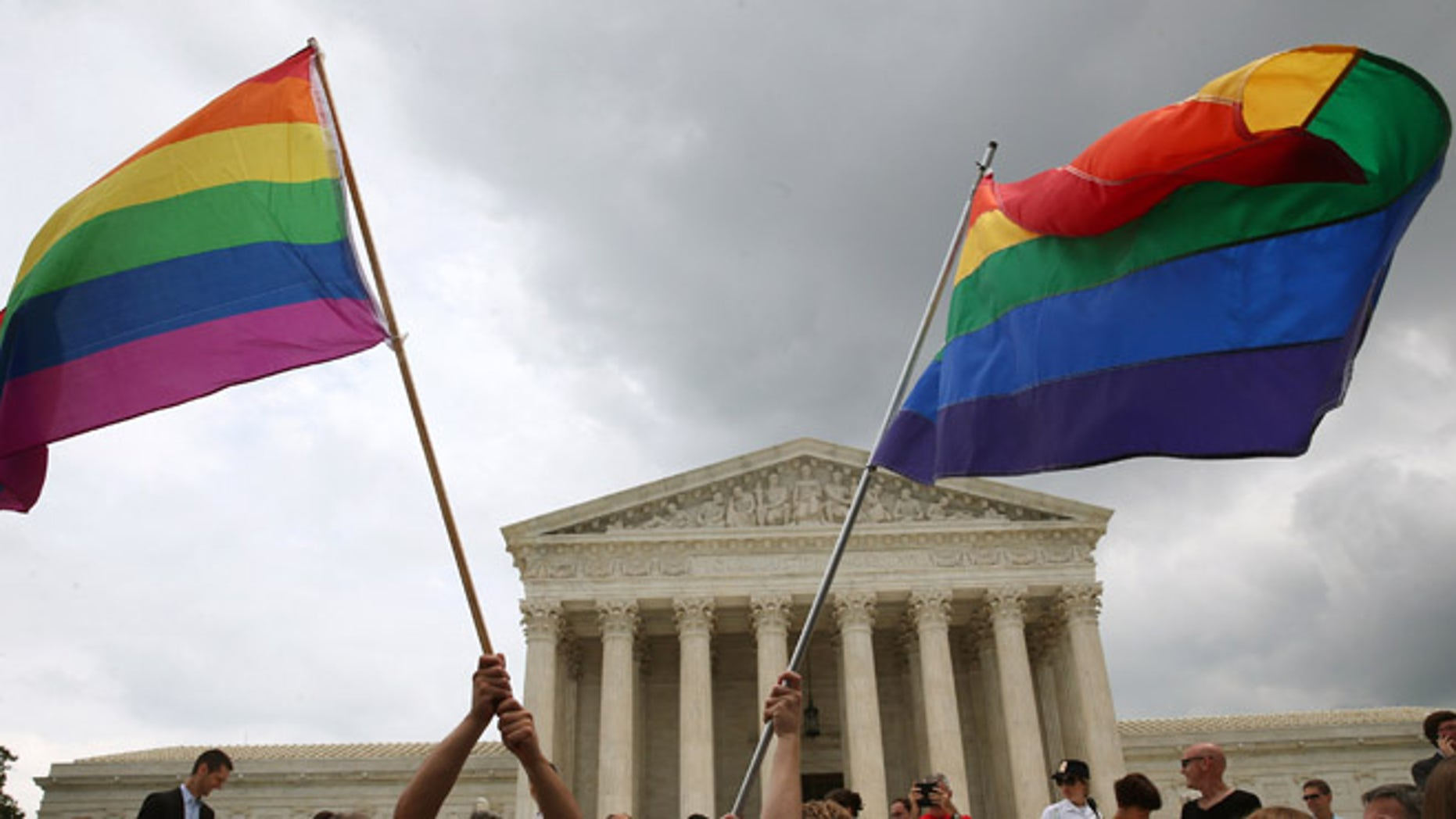 WASHINGTON, DC - JUNE 26: People celebrate in front of the U.S. Supreme Court after the ruling in favor of same-sex marriage June 26, 2015 in Washington, DC. The high court ruled that same-sex couples have the right to marry in all 50 states.  (Photo by Mark Wilson/Getty Images)