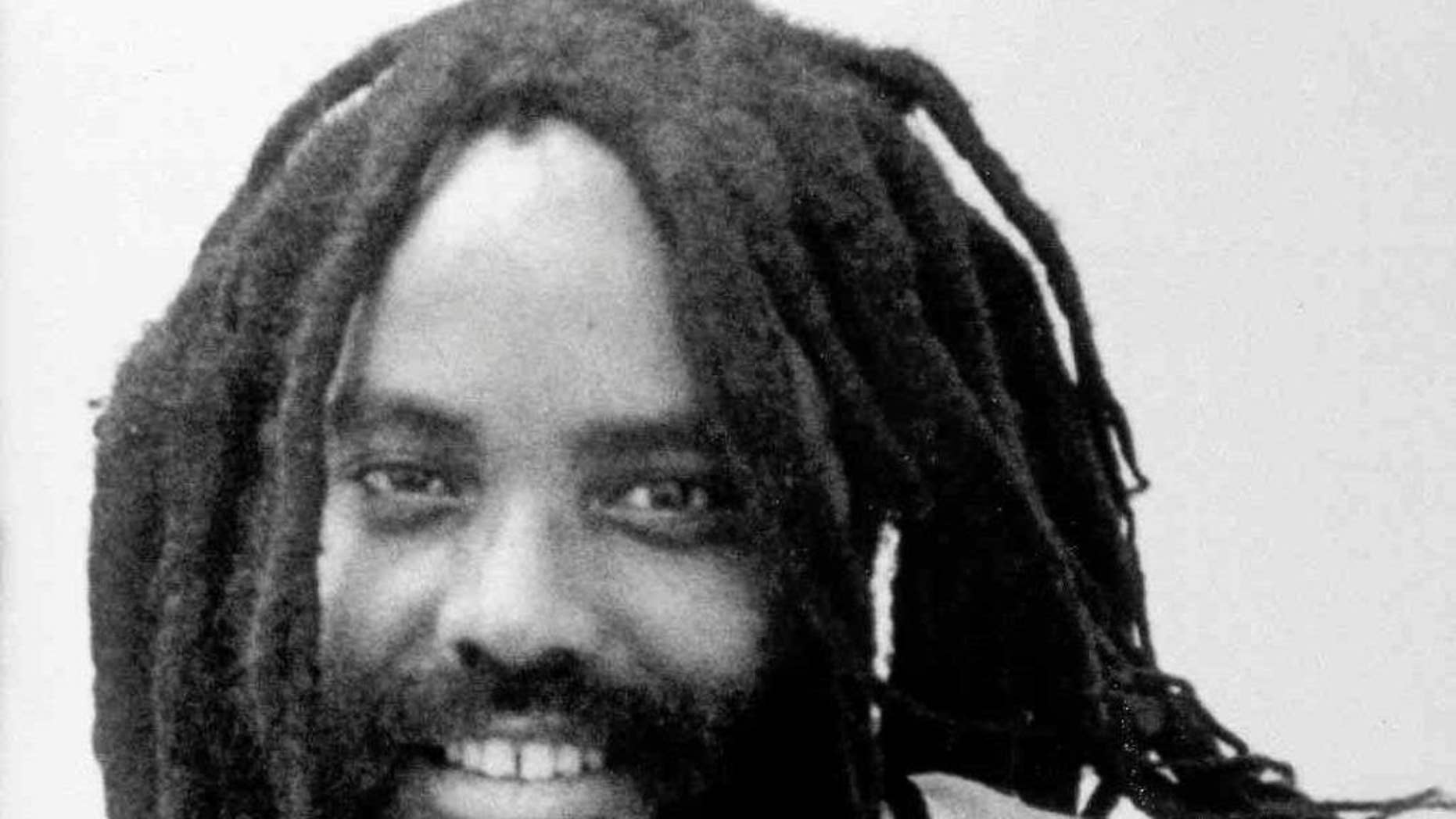 """FILE -This undated file photo shows convicted police killer Mumia Abu-Jamal. Former death row inmate Mumia Abu-Jamal will get a chance to tell a federal judge that his medical care for hepatitis C and other health problems has been inadequate. Claiming prison officials have shown  """"deliberate indifference"""" to his health, former death row inmate Mumia Abu-Jamal will get a chance to argue his case before a federal judge on Friday, Dec. 18, 2015. (AP Photo/Jennifer E. Beach, File)"""