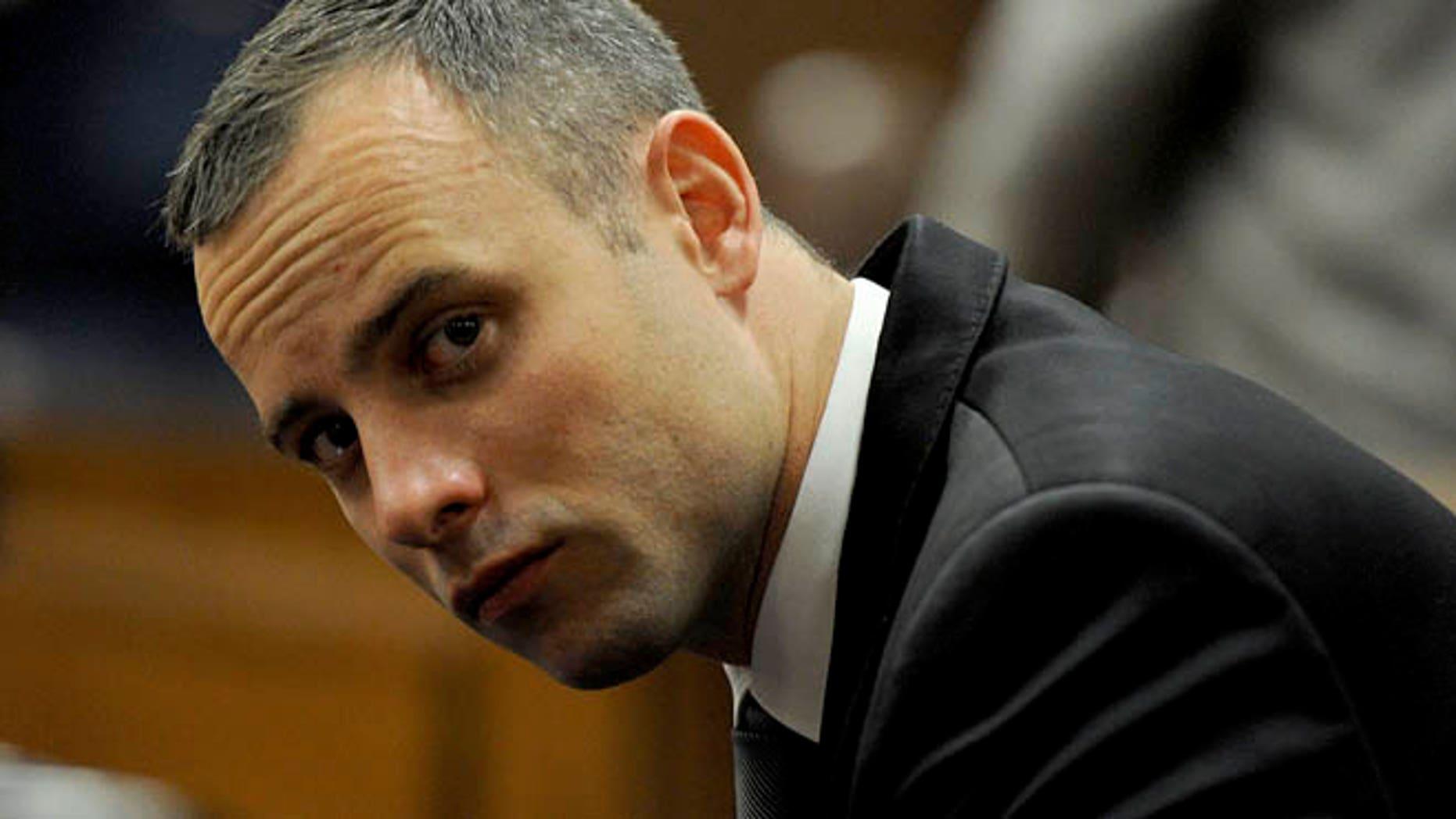May 12, 2014: Oscar Pistorius sits in court for his ongoing murder trial in Pretoria, South Africa.