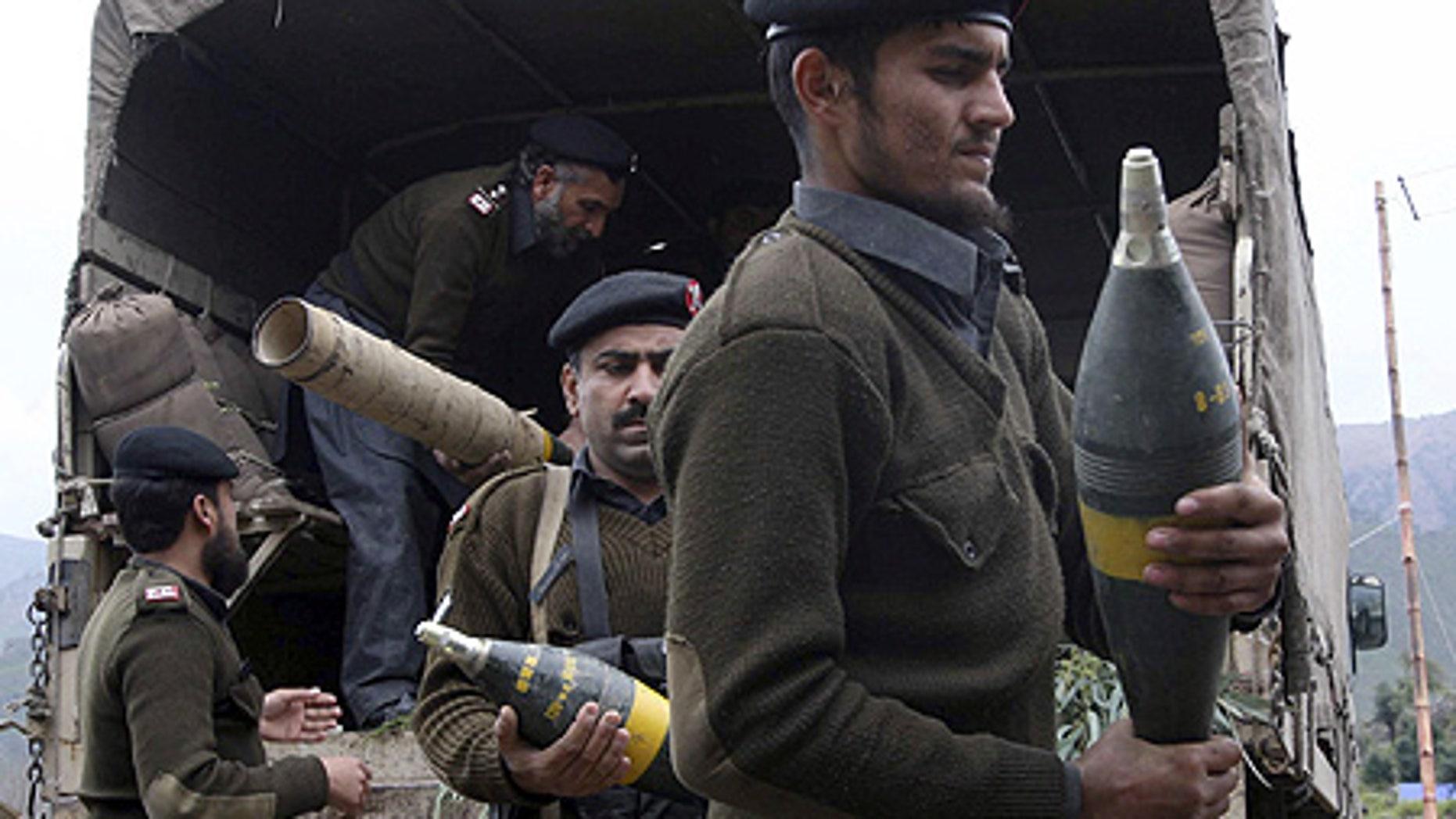 Mar. 3: Pakistan's paramilitary force carry ammunition confiscated from Taliban militants in Dara Adam Khel near Peshawar, Pakistan.