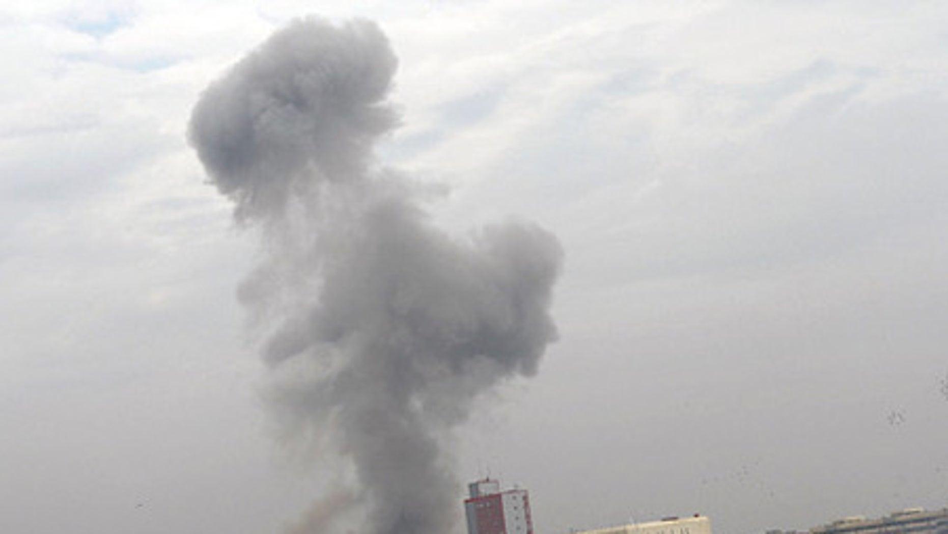 Dec. 8: Smoke billows following a deadly explosion in Baghdad, Iraq.