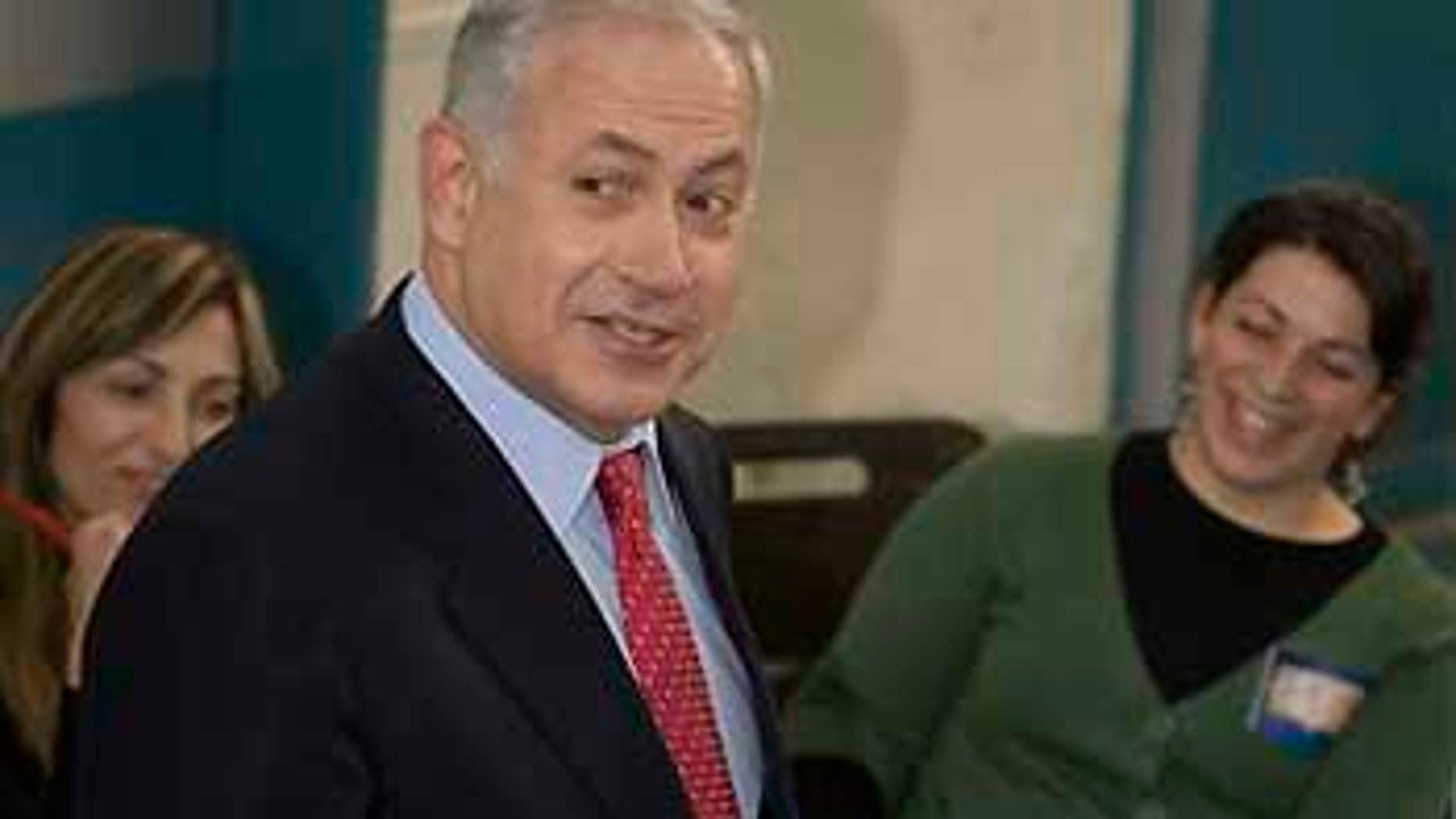 Feb. 10: Likud Party leader Benjamin Netanyahu casts his ballot in Israel's general election at a polling station in Jerusalem.