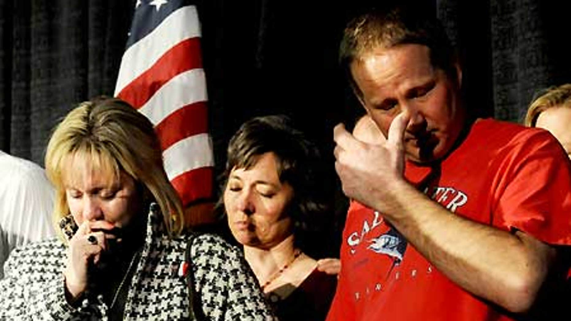 Feb. 18: Lisa Allen and her husband Jim Allen react during a welcome home rally at the Hospitality Room at the Amarillo Civic Center.