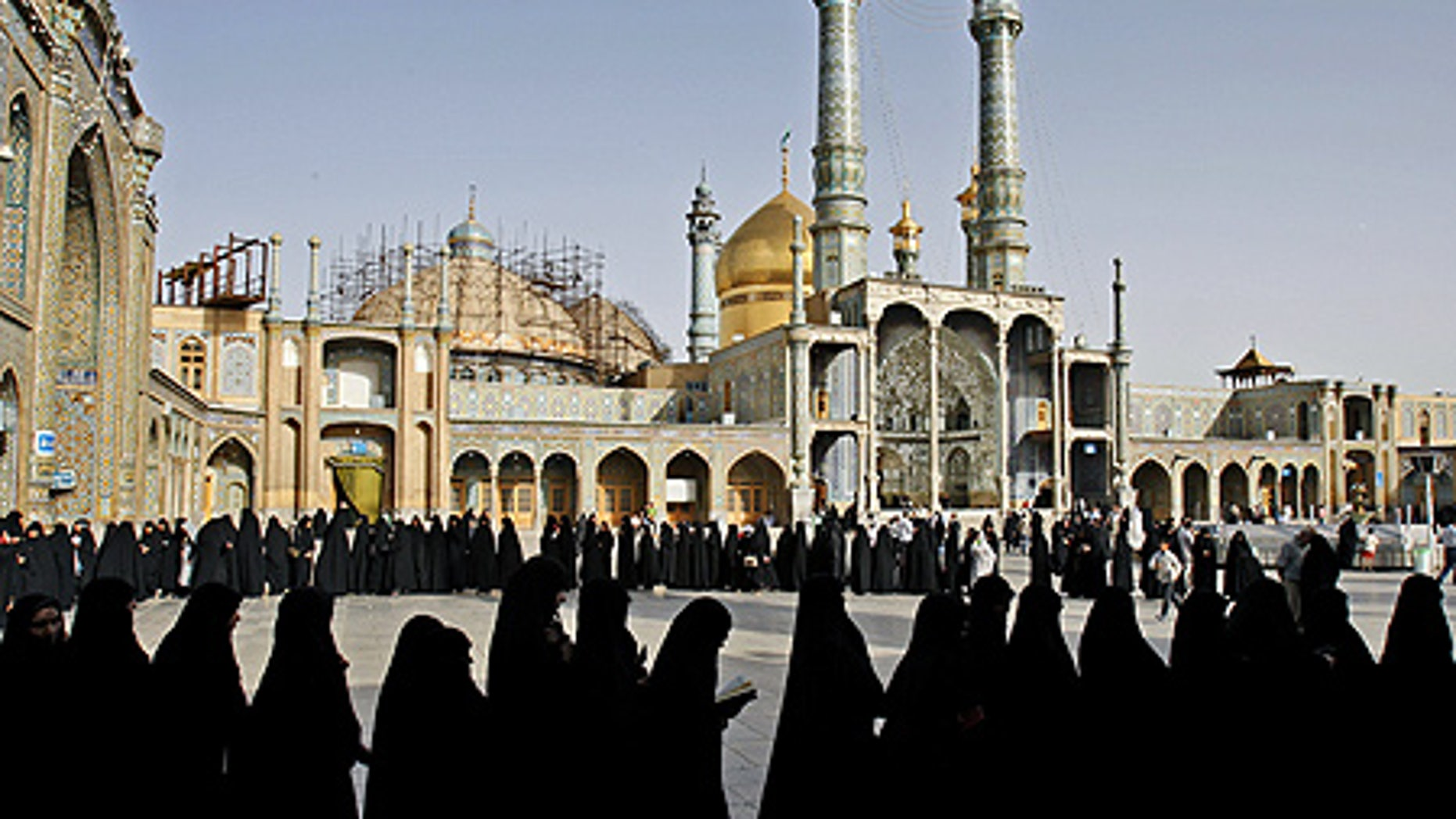 June 12: Iranian women stand in line to cast their votes at Masoumeh shrine in Qum, south of Tehran, Iran.