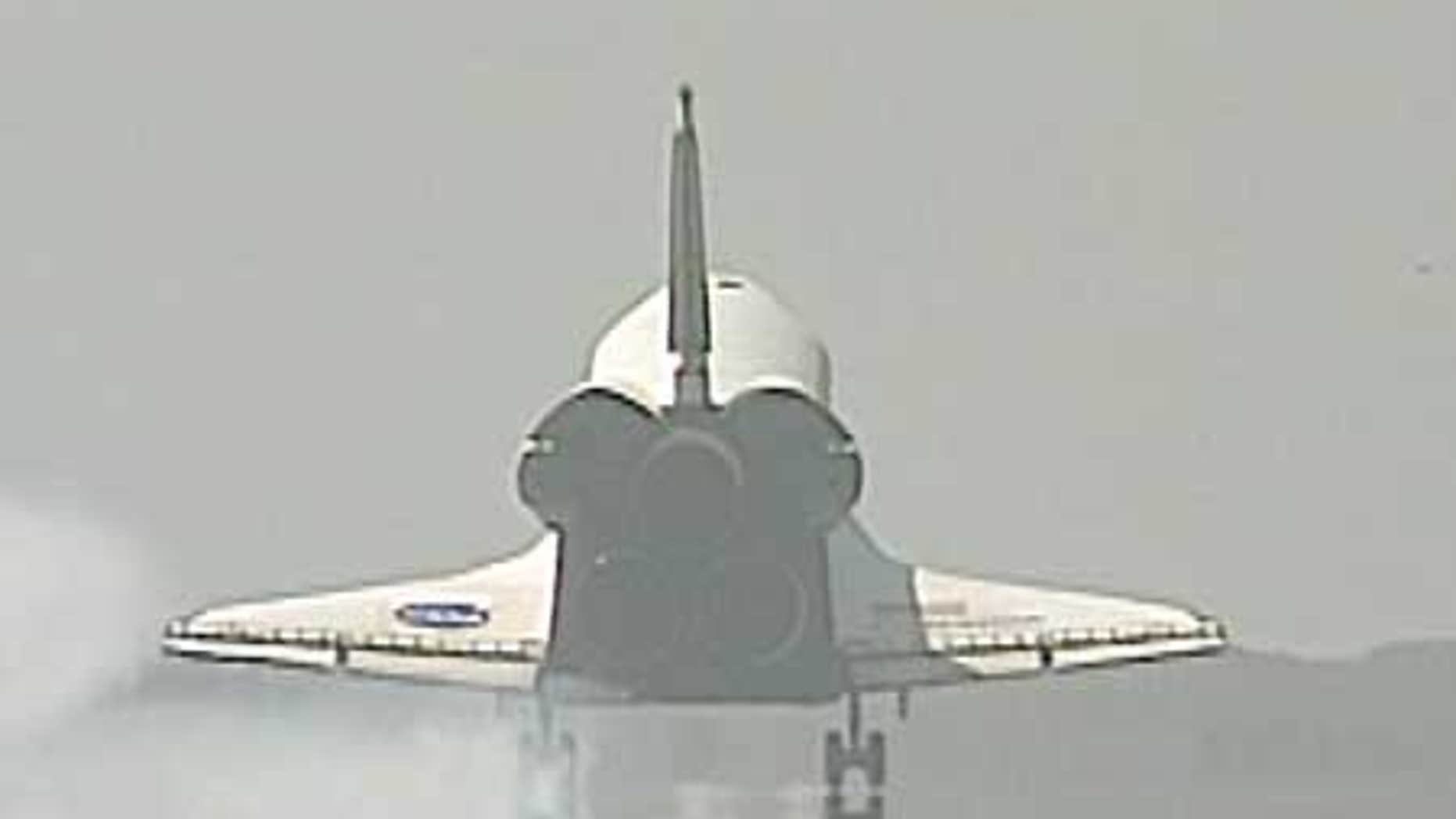 July 31: Space Shuttle Endeavour lands at the Kennedy Space Center, Florida.
