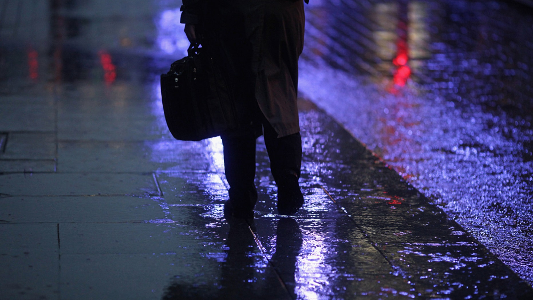 "GLASGOW, SCOTLAND - NOVEMBER 01: A man walks through a rain shower in Buchanan Street on November 1, 2010 in Glasgow, Scotland. According to a poll released today, 66% of Brits will feel depressed due to it being ""the most miserable day of the year"". The changing of UK clocks, falling temperatures and impending government cuts factor into the research, which was carried out by the Canary Islands Tourist Board. Furthermore, Glasgow residents top the poll, followed by the people of Newcastle, Sheffield, Cardiff and London.  (Photo by Jeff J Mitchell/Getty Images)"