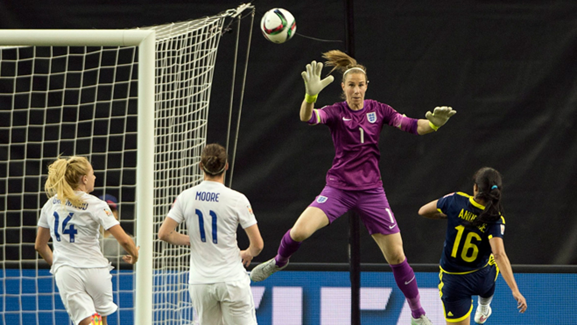 Colombia's Lady Andrade scores on England's goalkeeper Karen Bardsley as England's Alex Greenwood, left, and Jode Moore look on during the second half of a FIFA Women's World Cup soccer match, Wednesday, June 17, 2015, in Montreal, Canada. (Ryan Remiorz/The Canadian Press via AP) MANDATORY CREDIT