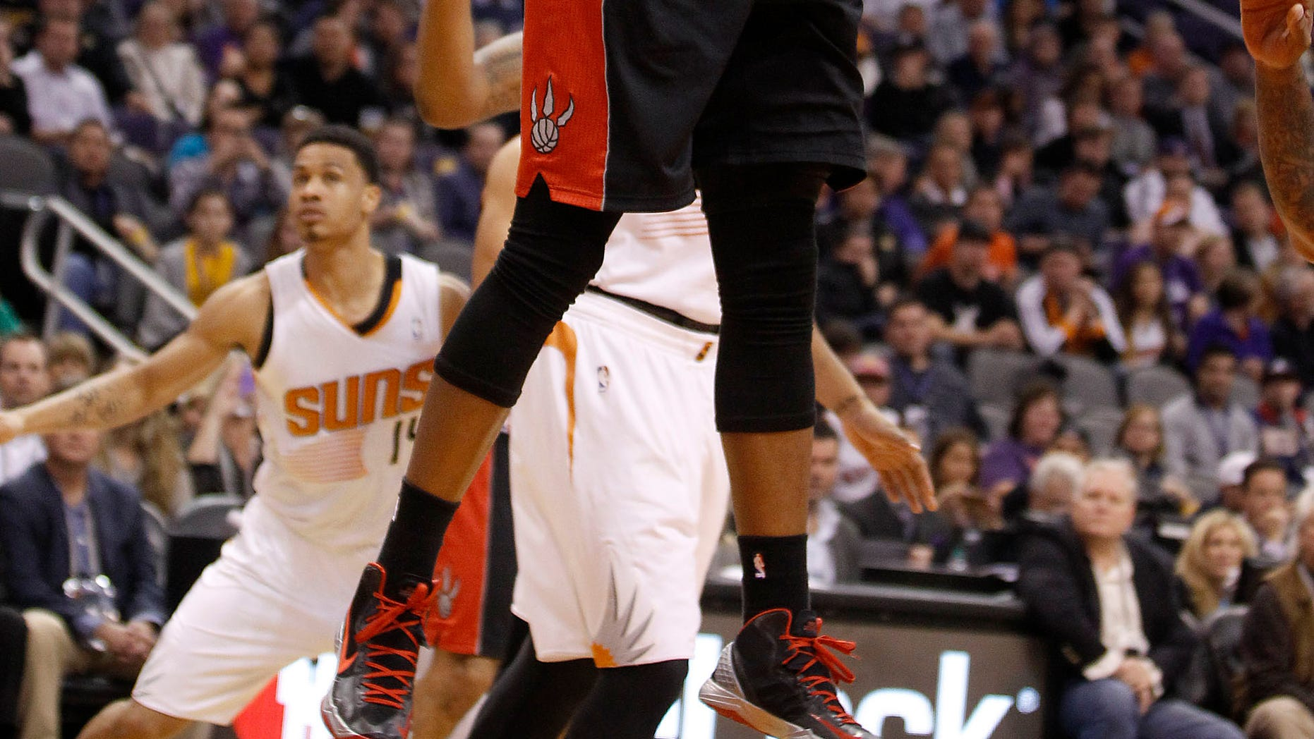Toronto Raptors' Rudy Gay (22) drives to the basket against the Phoenix Suns during the second half of an NBA basketball game Friday, Dec. 6, 2013 in Phoenix. (AP Photo/Ralph Freso)