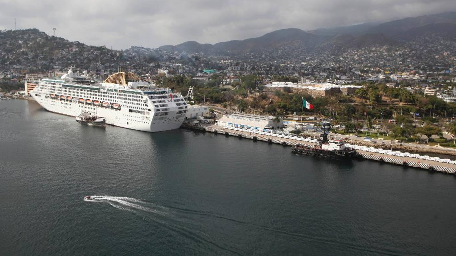 FILE - In this Jan. 16, 2011 file photo, a cruise ship is docked at the port in Acapulco, Mexico. The U.S. government on Friday, April 15, 2016 barred its employees from traveling to the Mexican resort city of Acapulco, where a rise in homicides attributed to drug gangs has made it one of the world's deadliest cities in recent years. (AP Photo/Alexandre Meneghini, File)