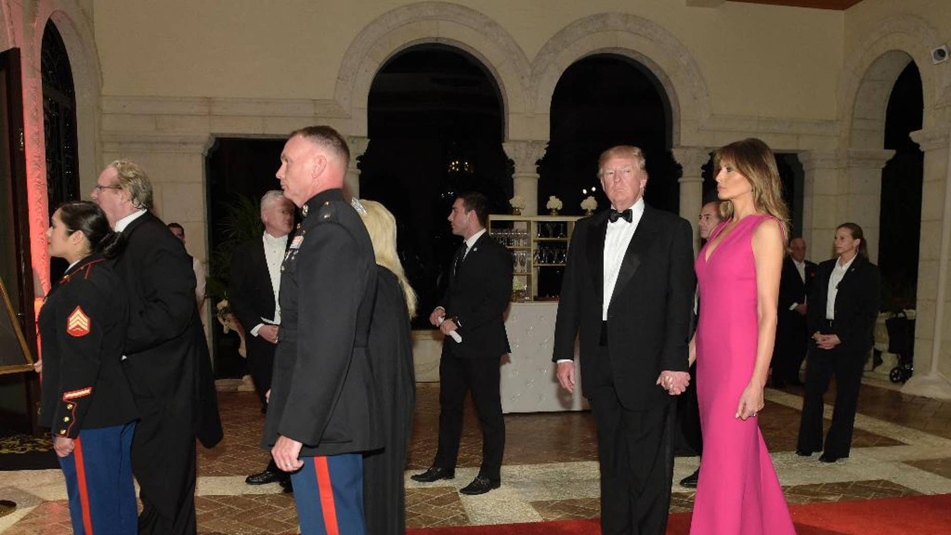 President Donald Trump and first lady Melania Trump arrive for the 60th annual Red Cross Gala at Trump's Mar-a-Lago resort in Palm Beach, Fla., Saturday, Feb. 4, 2017. (AP Photo/Susan Walsh)