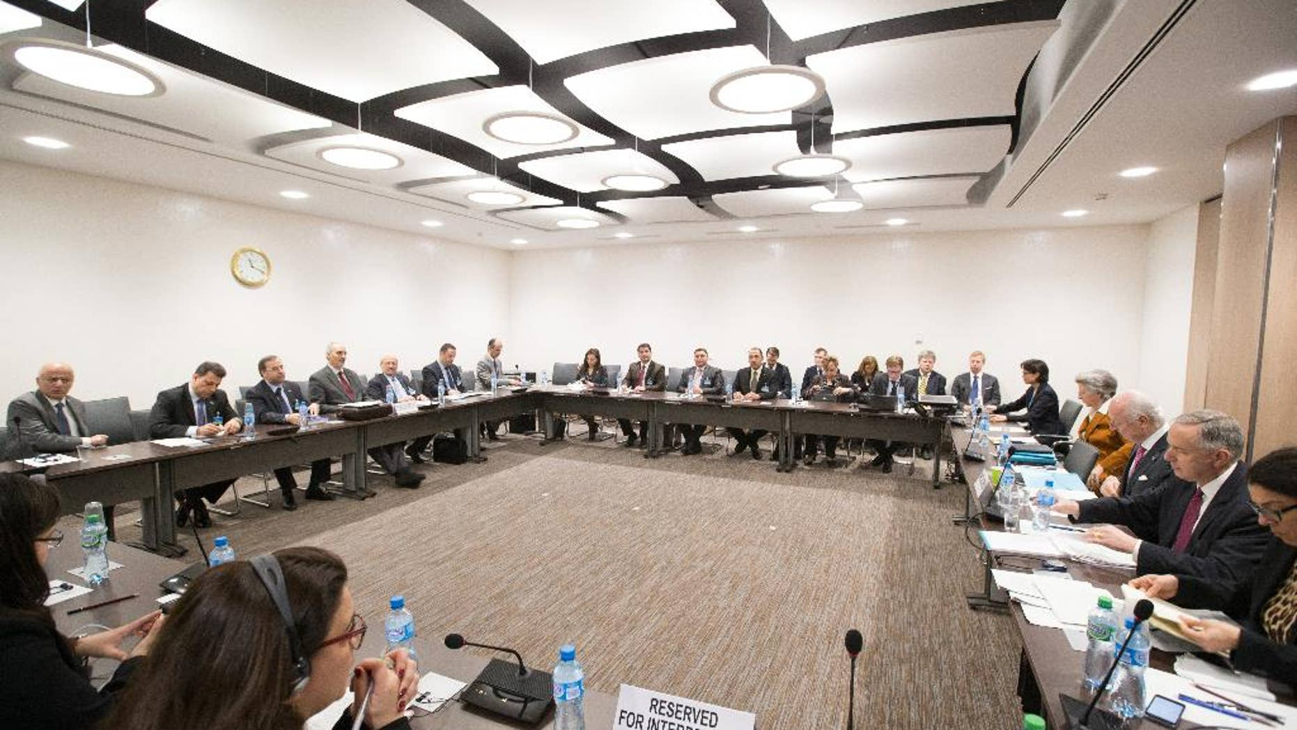 A general view of a meeting of Intra-Syria peace talks with Syrian government delegation and UN Syria envoy Staffan de Mistura, third from right, at Palais des Nations in Geneva, Switzerland, Monday, April 25, 2016. (Xu Jinquan/pool photo via AP)