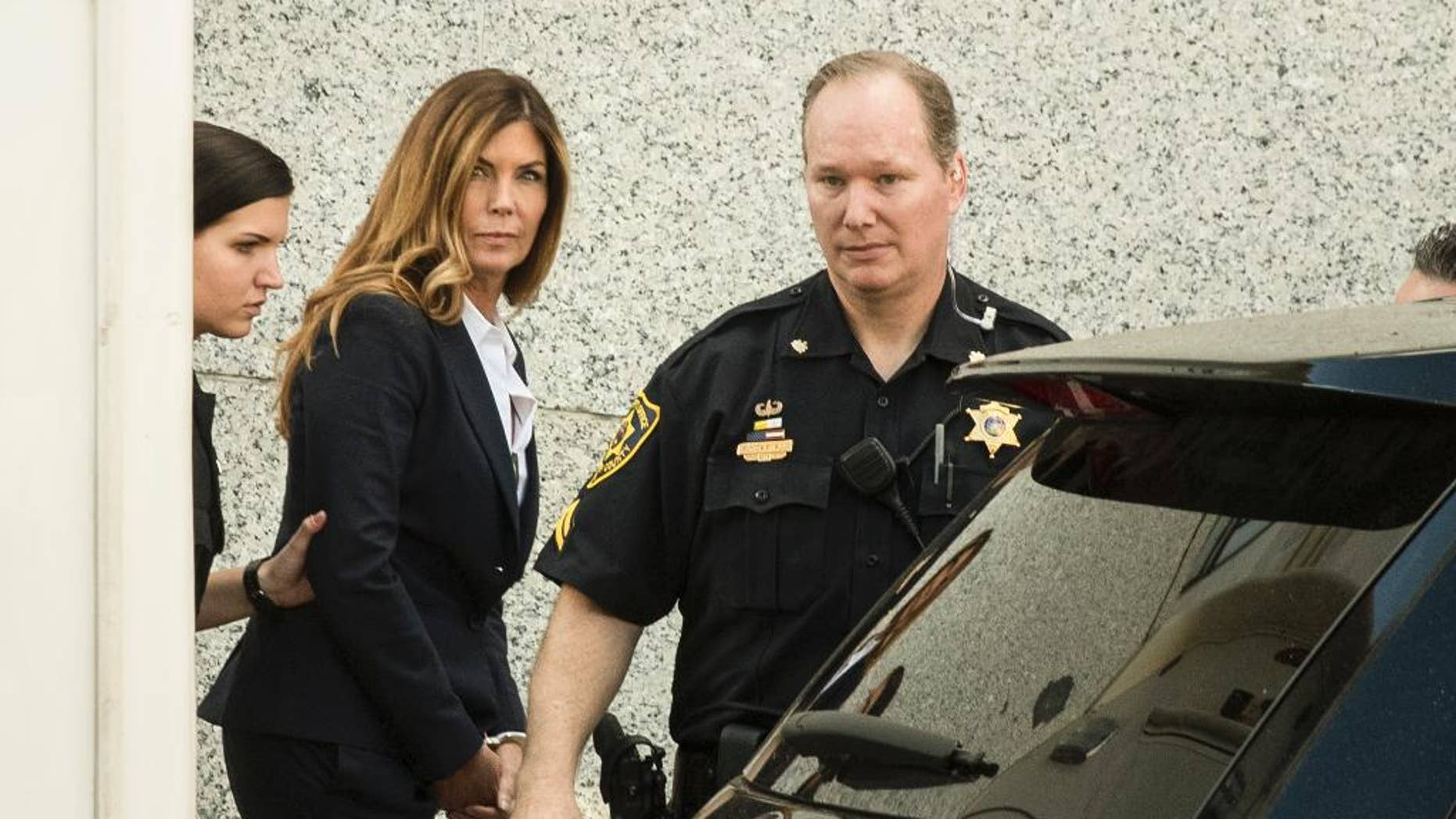 Former Pennsylvania Attorney General Kathleen Kane was sentenced to 10 to 23 months in jail for illegally disclosing details from a grand jury investigation to embarrass a rival and lying about it under oath. (AP Photo/Matt Rourke)