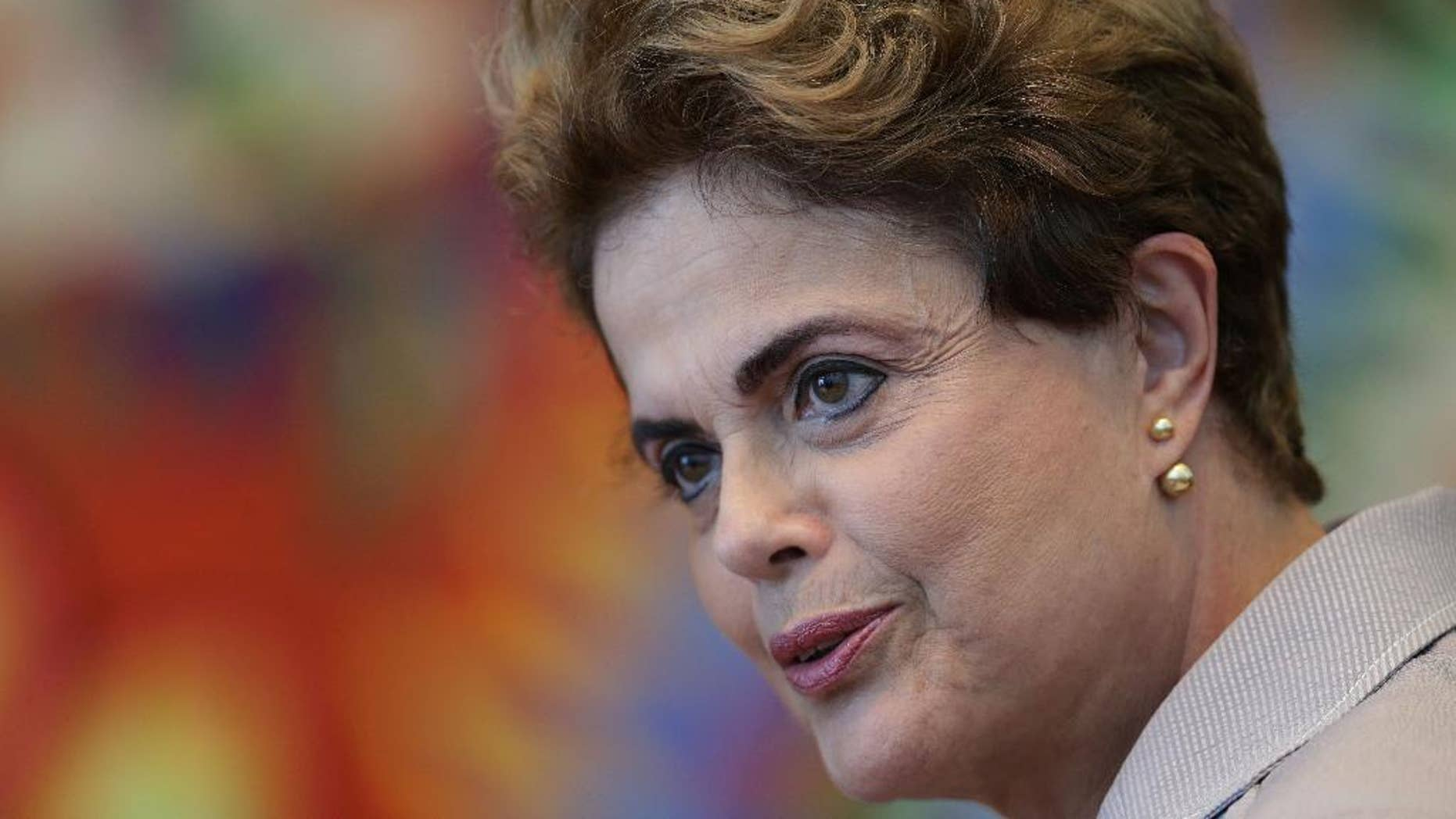 FILE - In this June 14, 2016 file photo, suspended Brazilian President Dilma Rousseff speaks during a press conference for foreign journalists at the Alvorada residential palace, in Brasilia, Brazil. Brazil's Senate voted Wednesday, Aug. 10, 2016, to put Rousseff on trial for allegedly breaking fiscal rules in her managing of the federal budget. (AP Photo/Eraldo Peres, File)