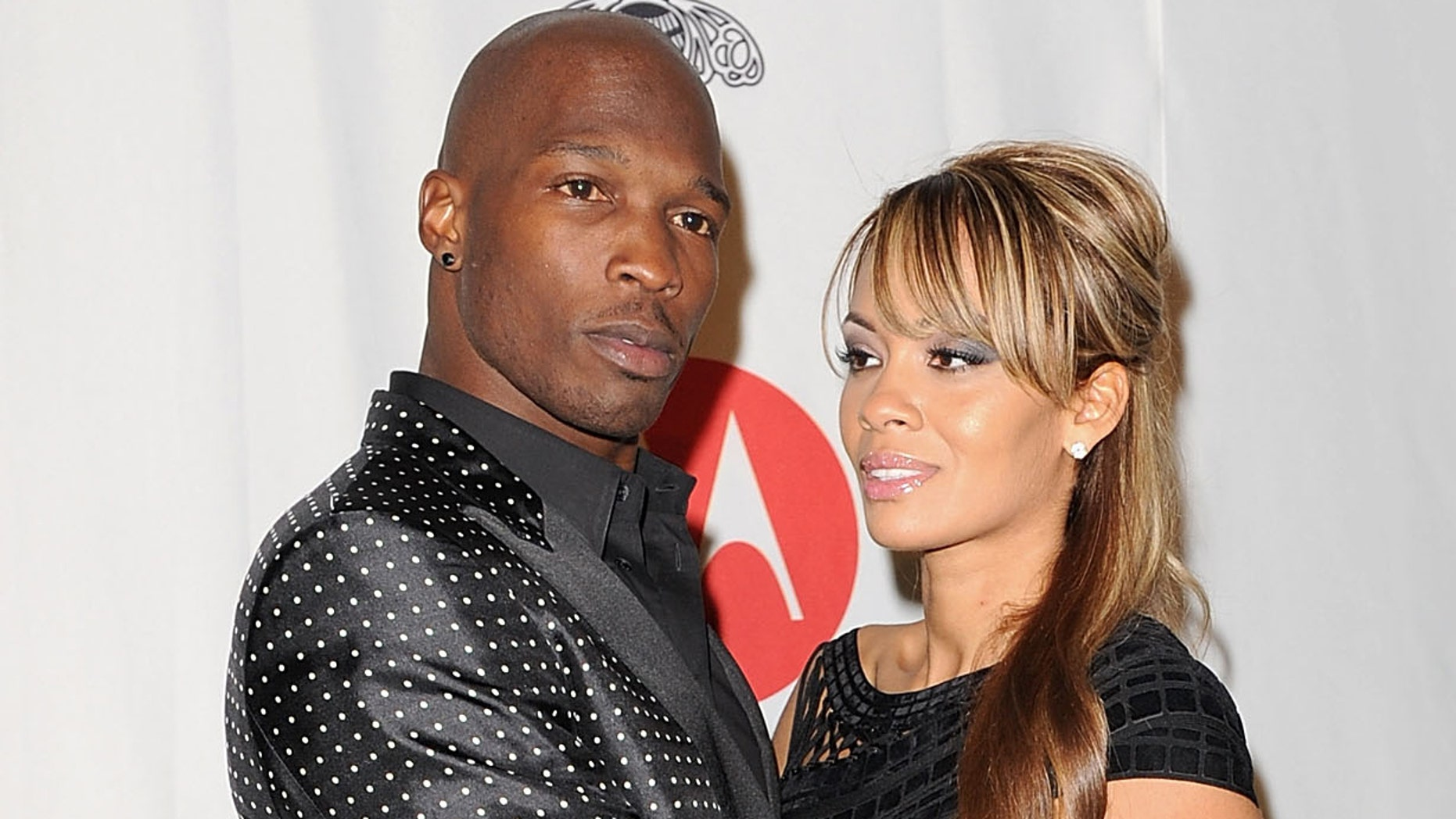 DALLAS, TX - FEBRUARY 05:  NFL player Chad Ochocinco Johnson and Evelyn Lozada attend the Maxim Party Powered by Motorola Xoom at Centennial Hall at Fair Park on February 5, 2011 in Dallas, Texas.  (Photo by Gustavo Caballero/Getty Images for Maxim)