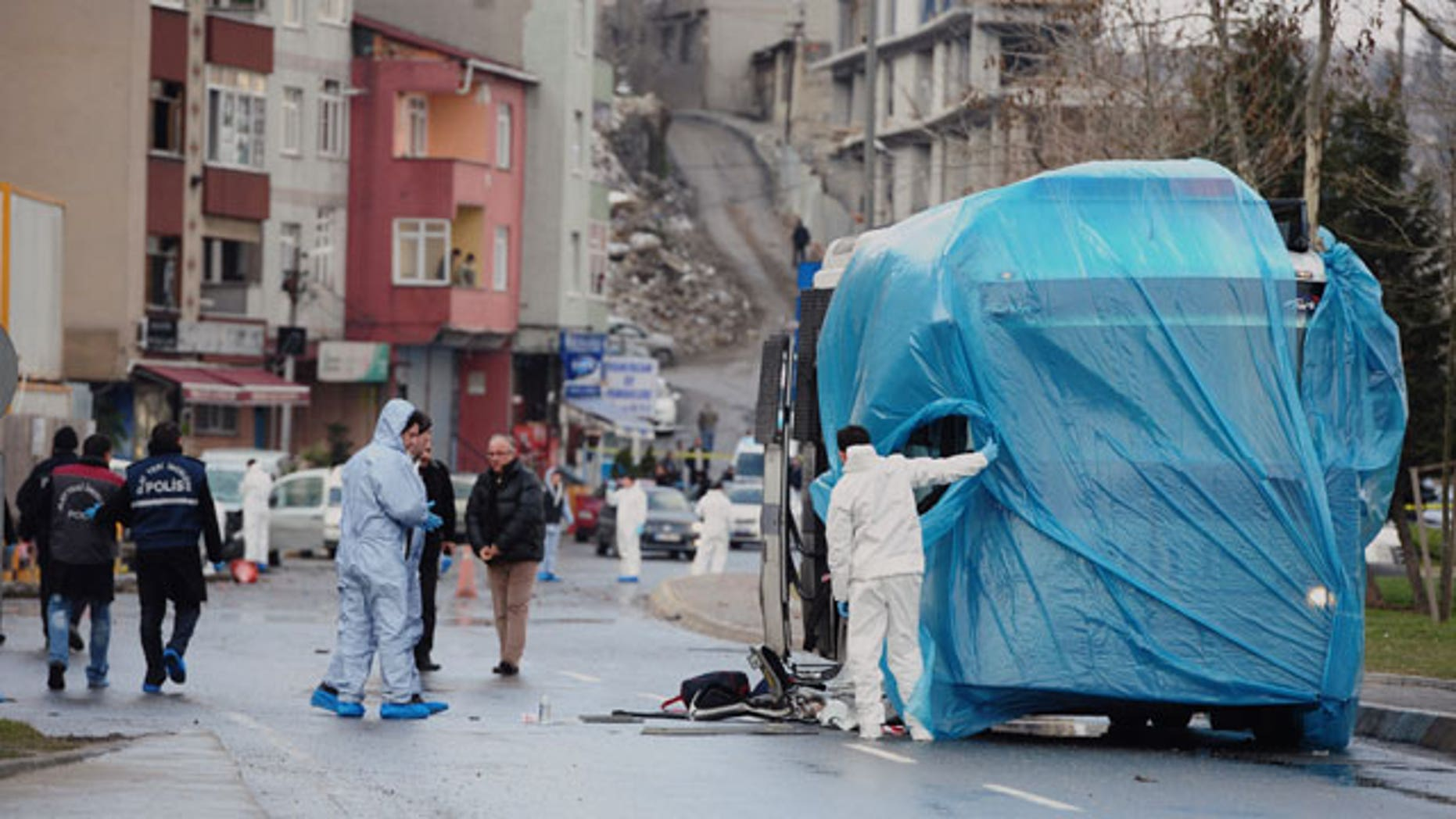 March 1, 2012: Forensic police cover a damaged police vehicle after a bomb went off near the country's ruling party offices in Turkey's largest city, Istanbul.